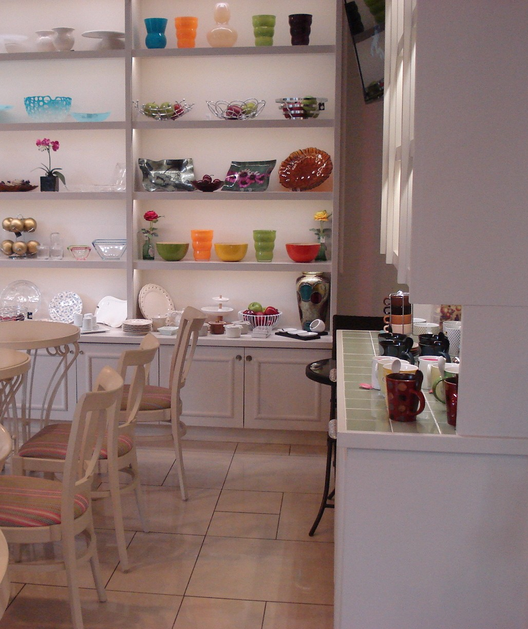 Picture of white interior of cafe with small dining tables
