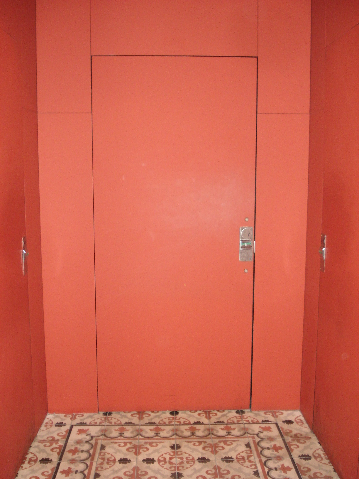 Picture of accessible washroom door.