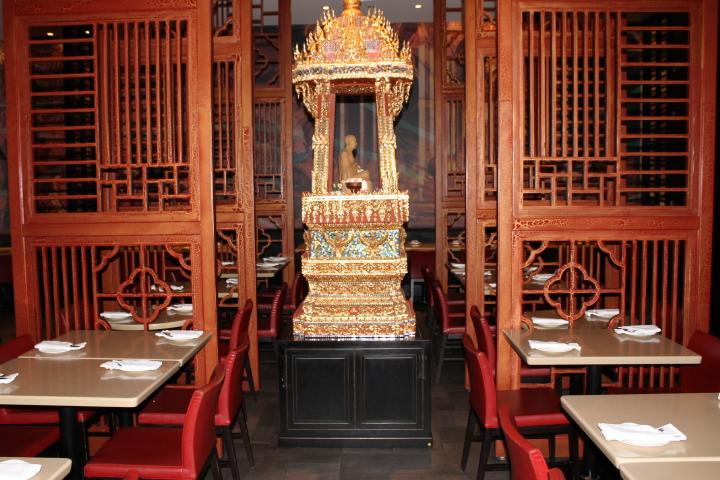 Picture of Thai sculpture inside restaurant.