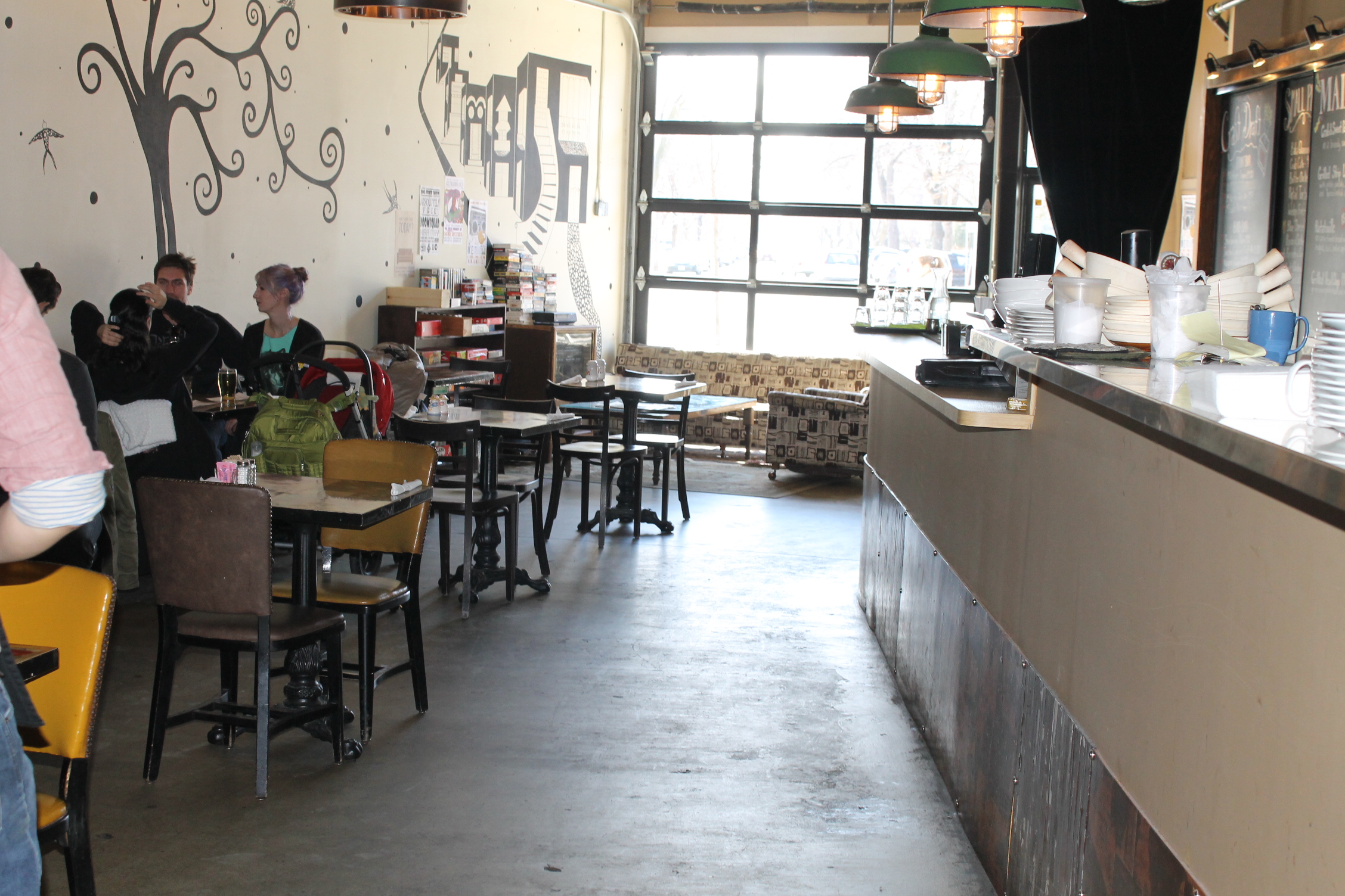 Picture of accessible interior of restaurant. Wide pathway displayed in front of kitchen