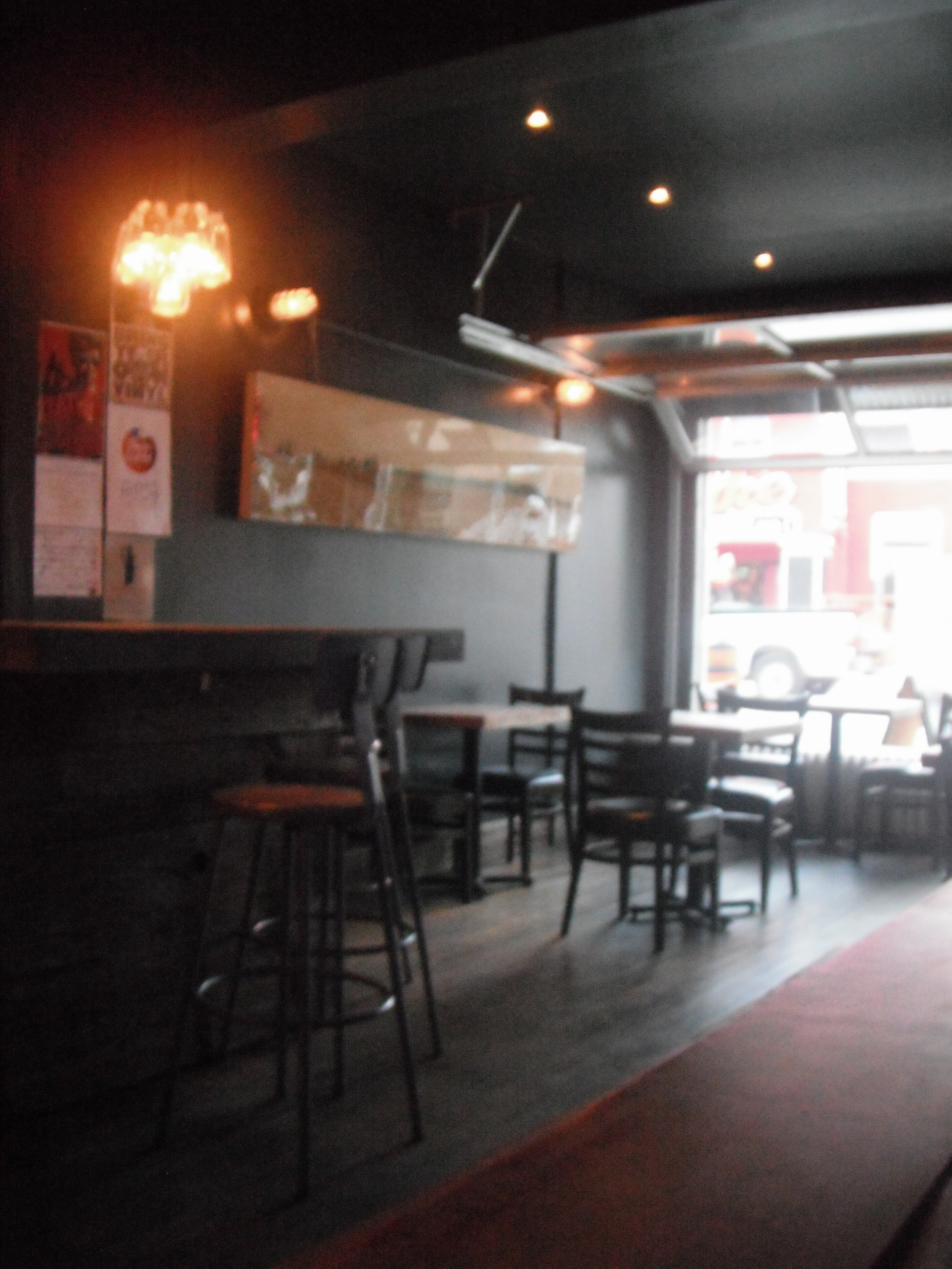 Picture of accessible interior of bar. Level floors, standard height tables.