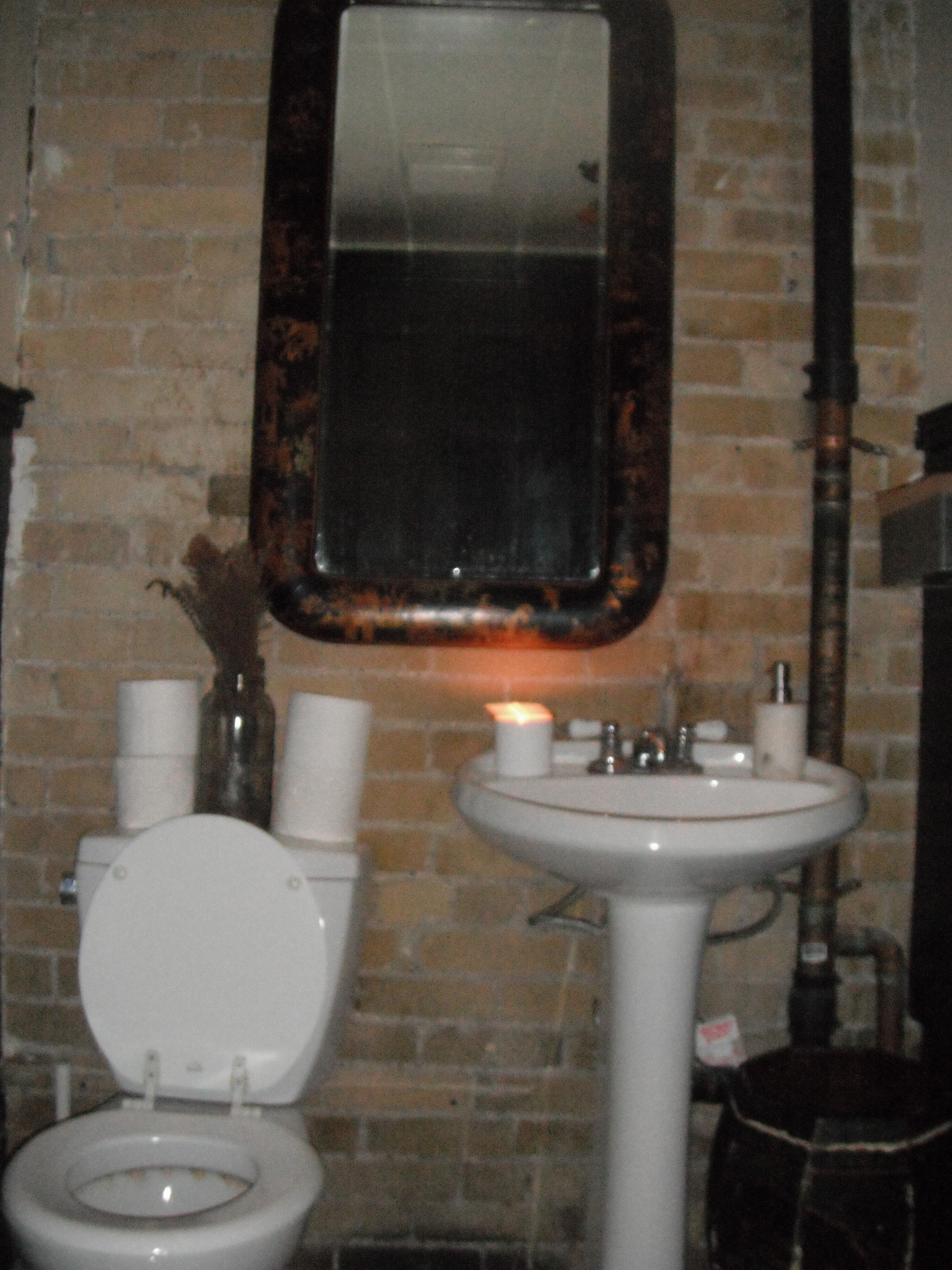 Picture of accessible washroom. Dim lighting.