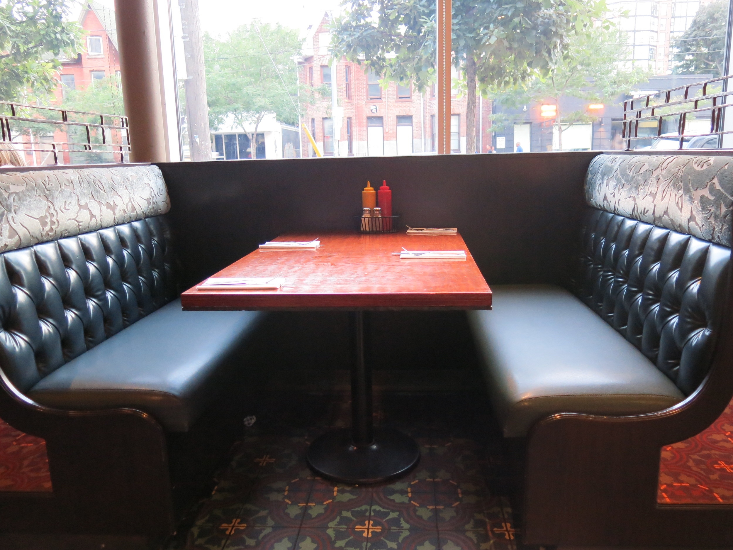 Picture of booth within restaurant.