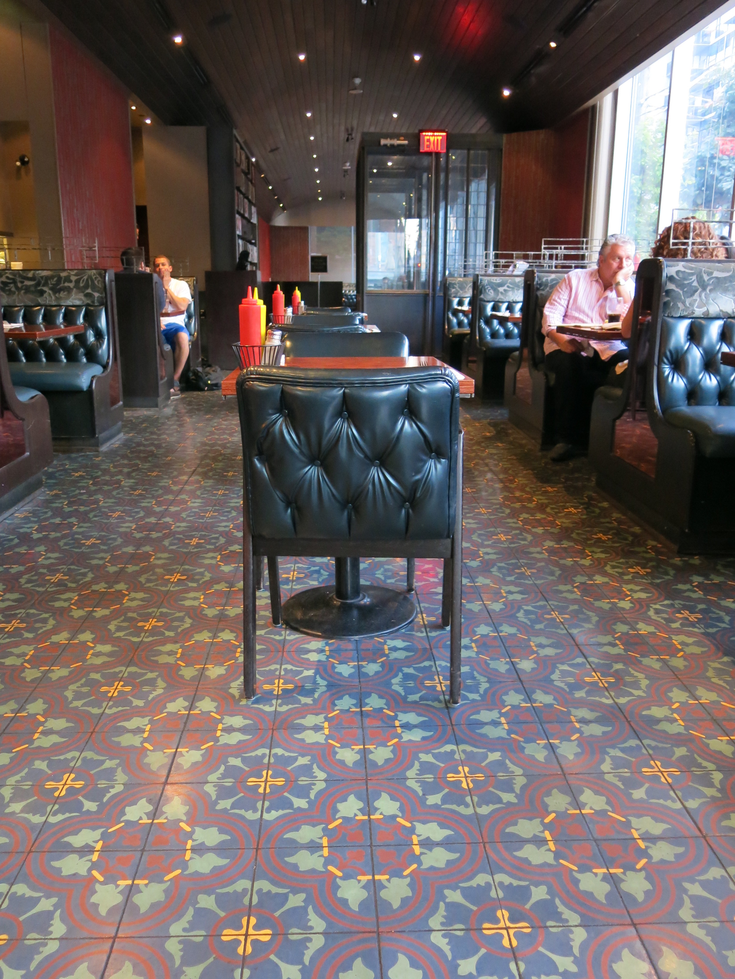 Picture of accessible interior of restaurant. Carpeted floors throughout.