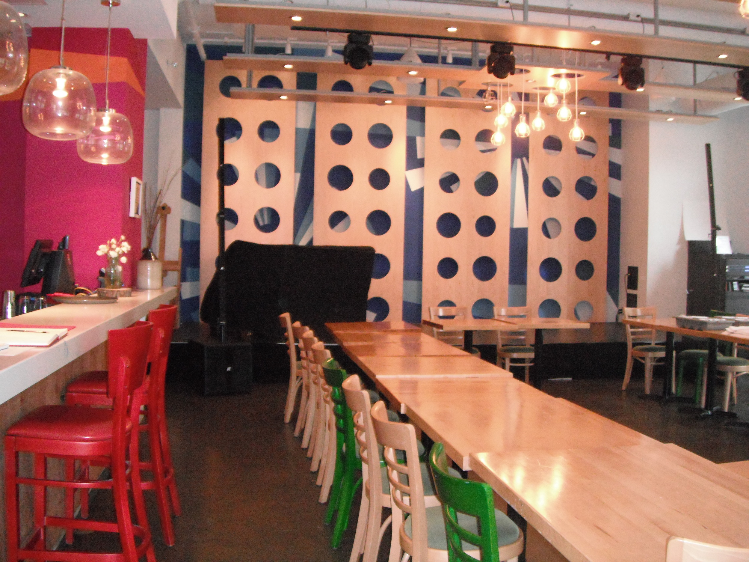 Picture of interior bar with stools as well as standard height dining tables