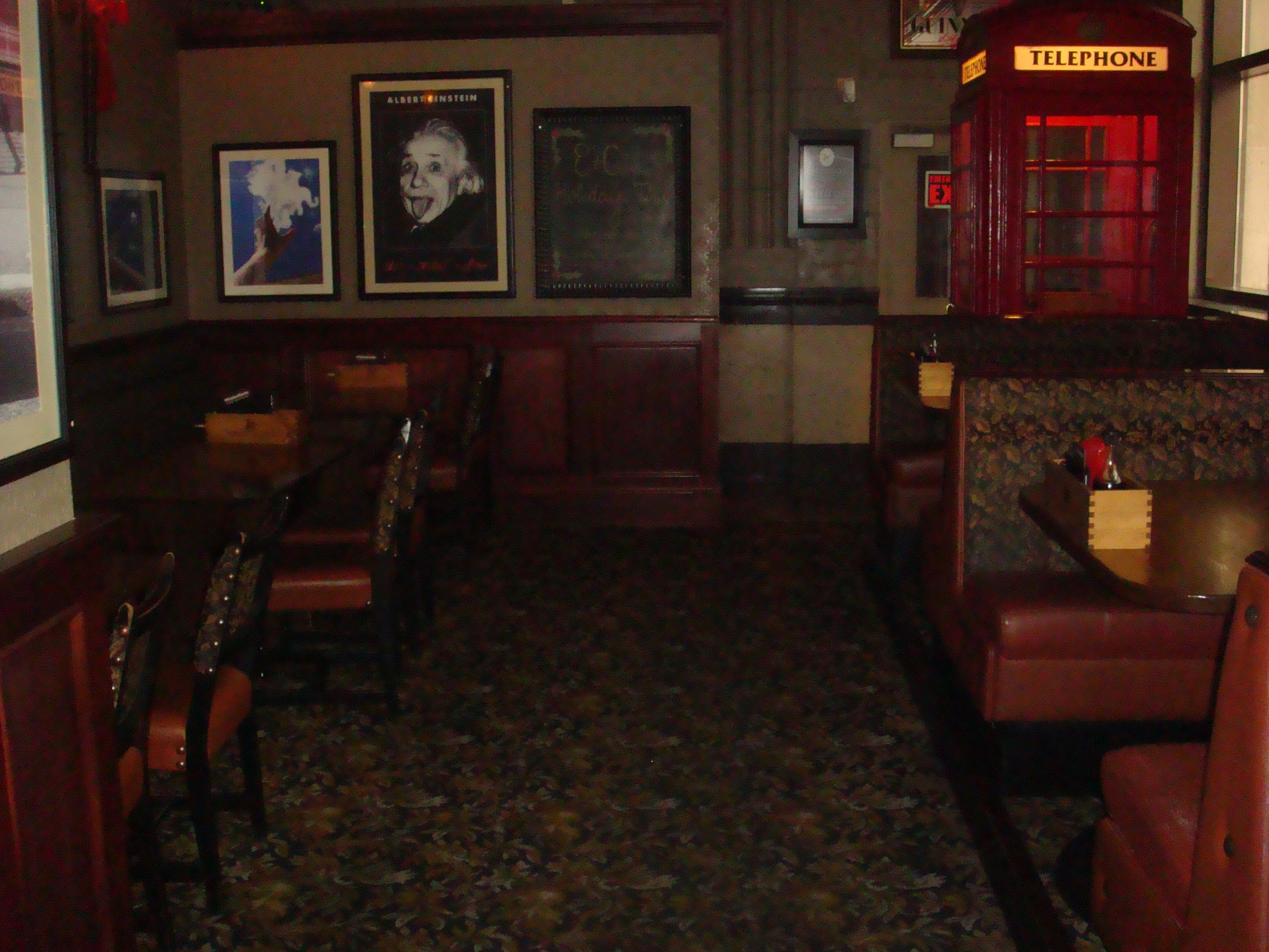 Picture of accessible interior of restaurant. Carpeted floors.
