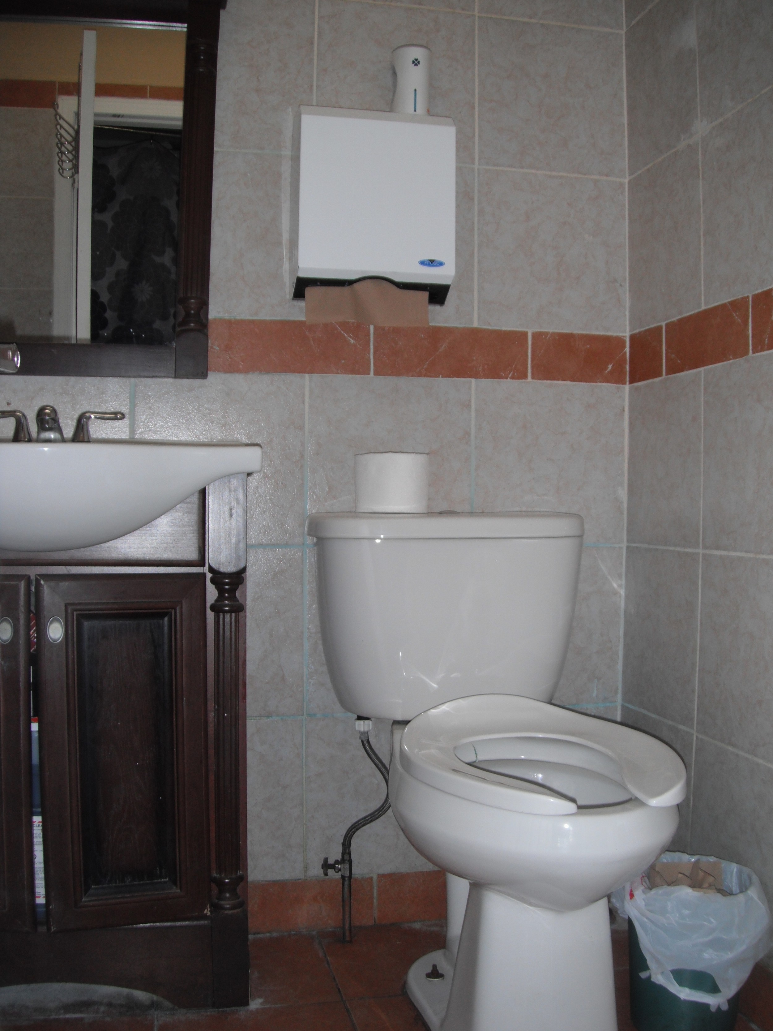 Picture of accessible washroom. No grab bars present.