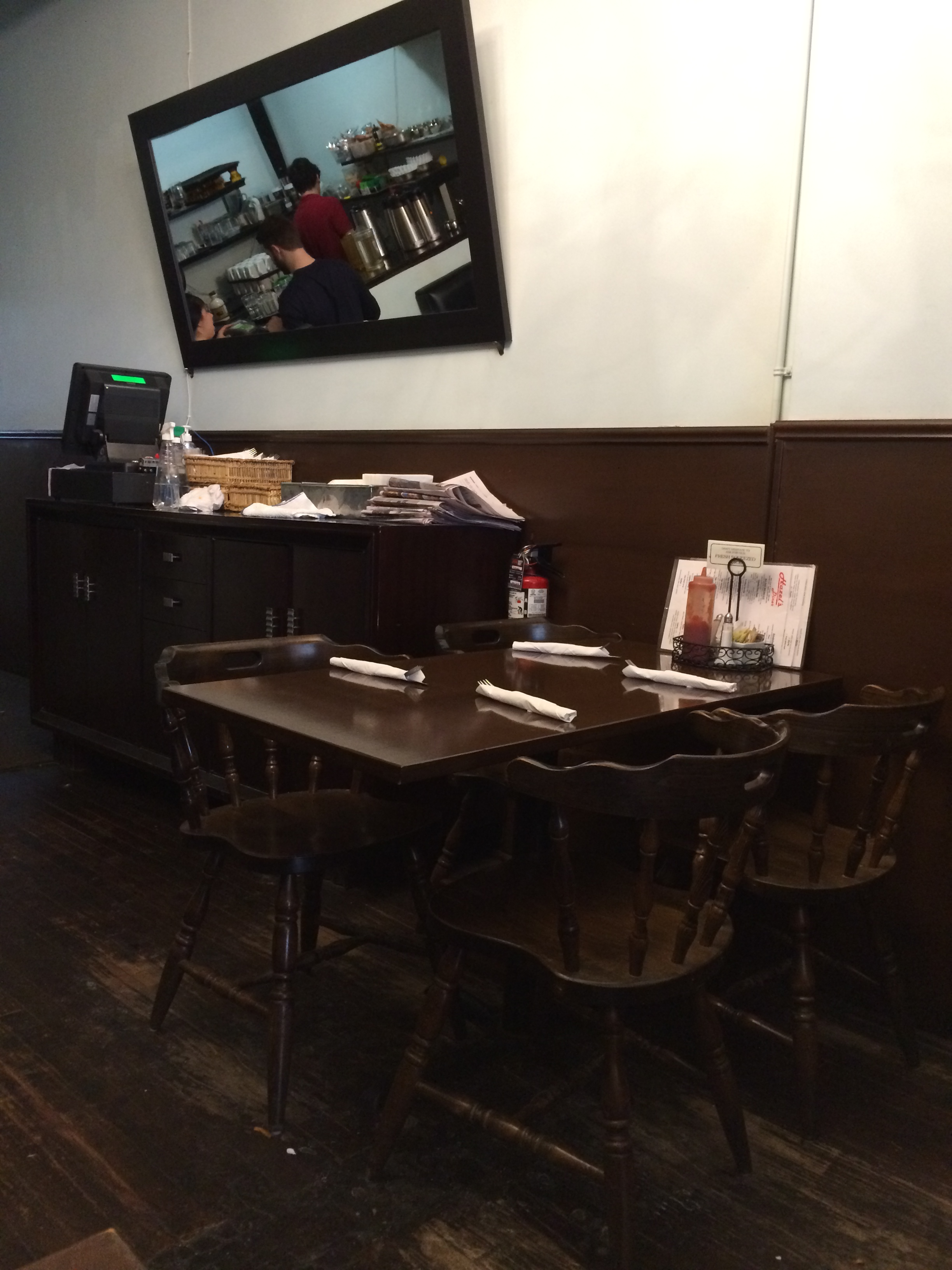 Picture of accessible interior. Standard height wooden tables with chairs.