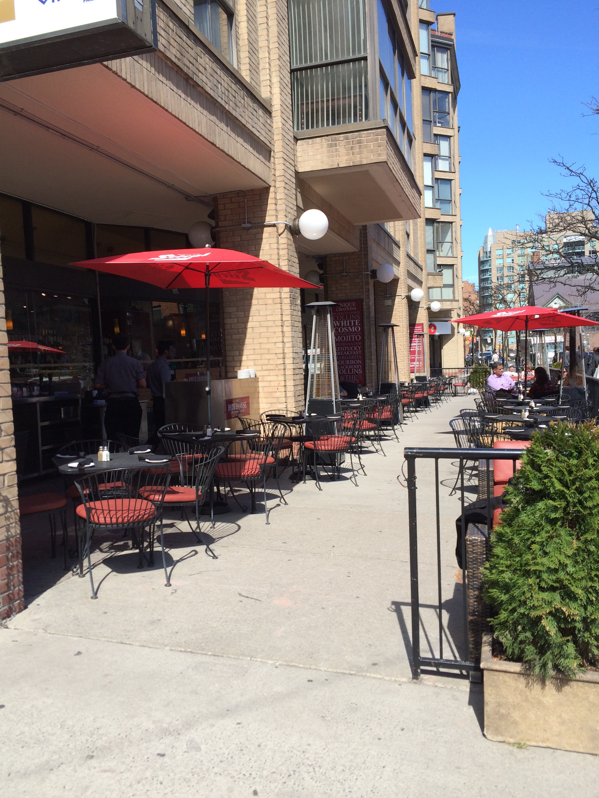 Picture of accessible patio. Red umbrellas.