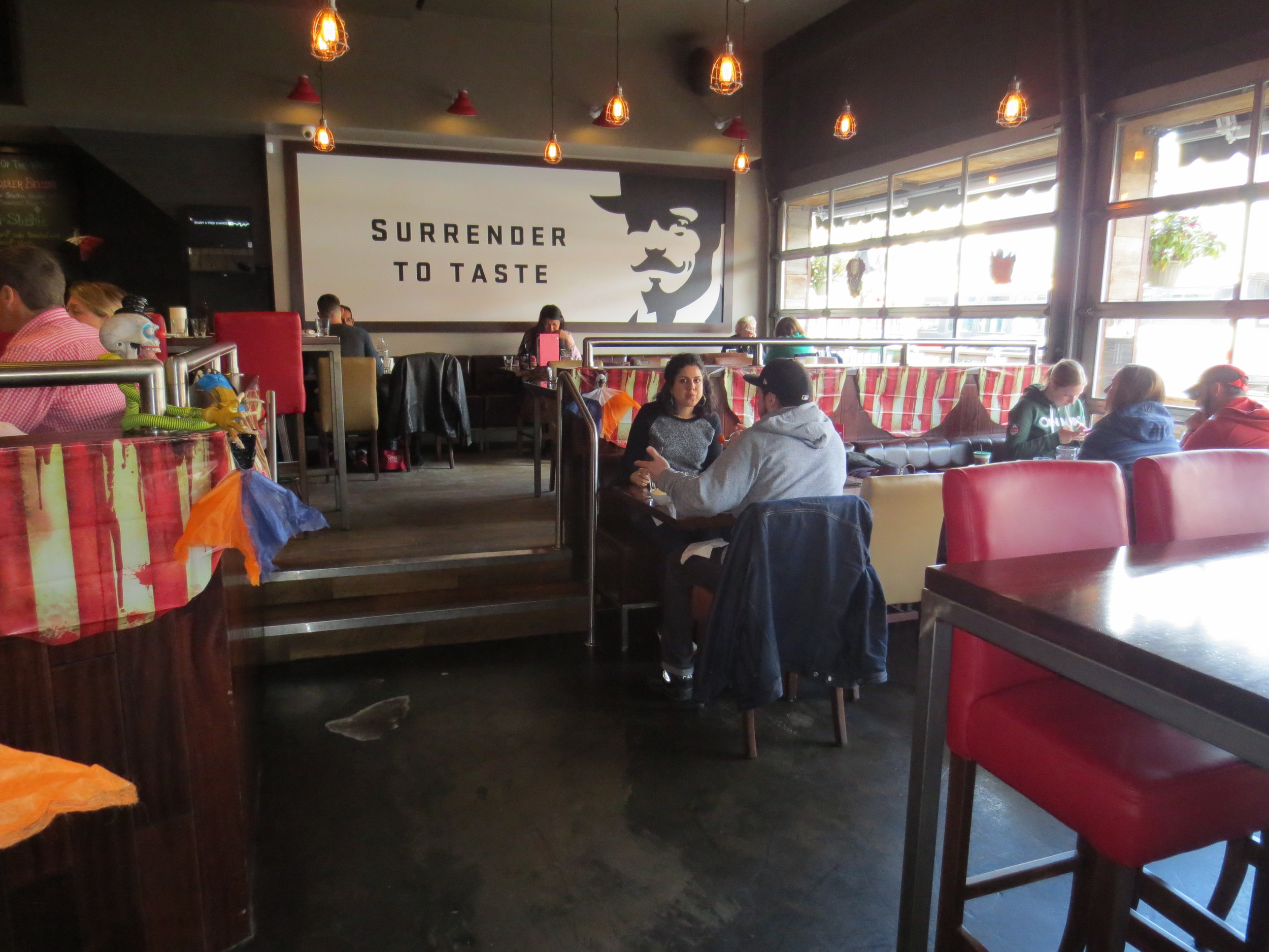 Picture of the main floor in Louis Cifer. Couple eating at table.