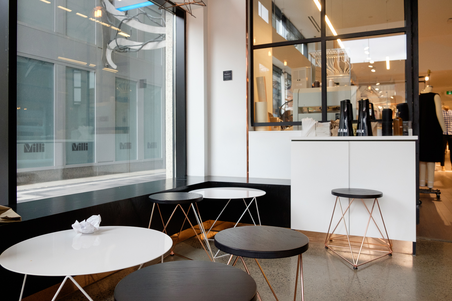 Picture of removable tables and chair inside the coffee shop