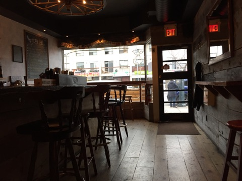Picture of bar and entrance of The Wren from the inside.