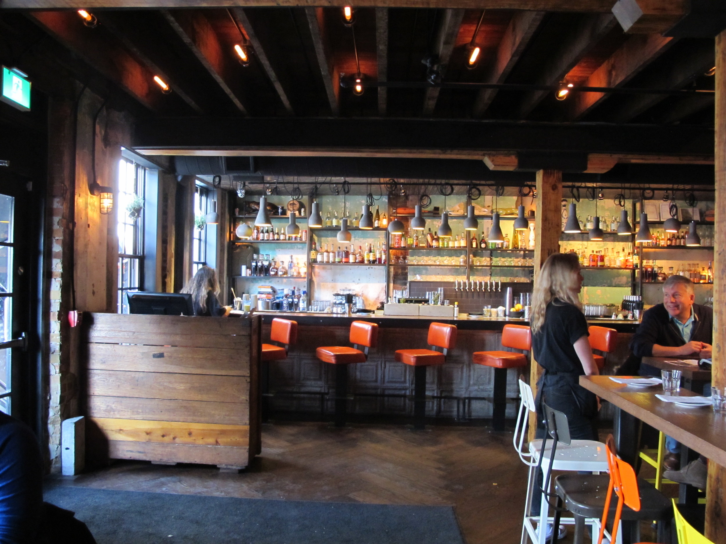 Picture of the main floor dining area. Orange bar height stools featured