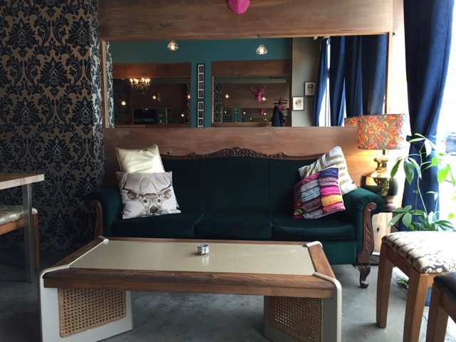 Picture of green couch and coffee table for seating