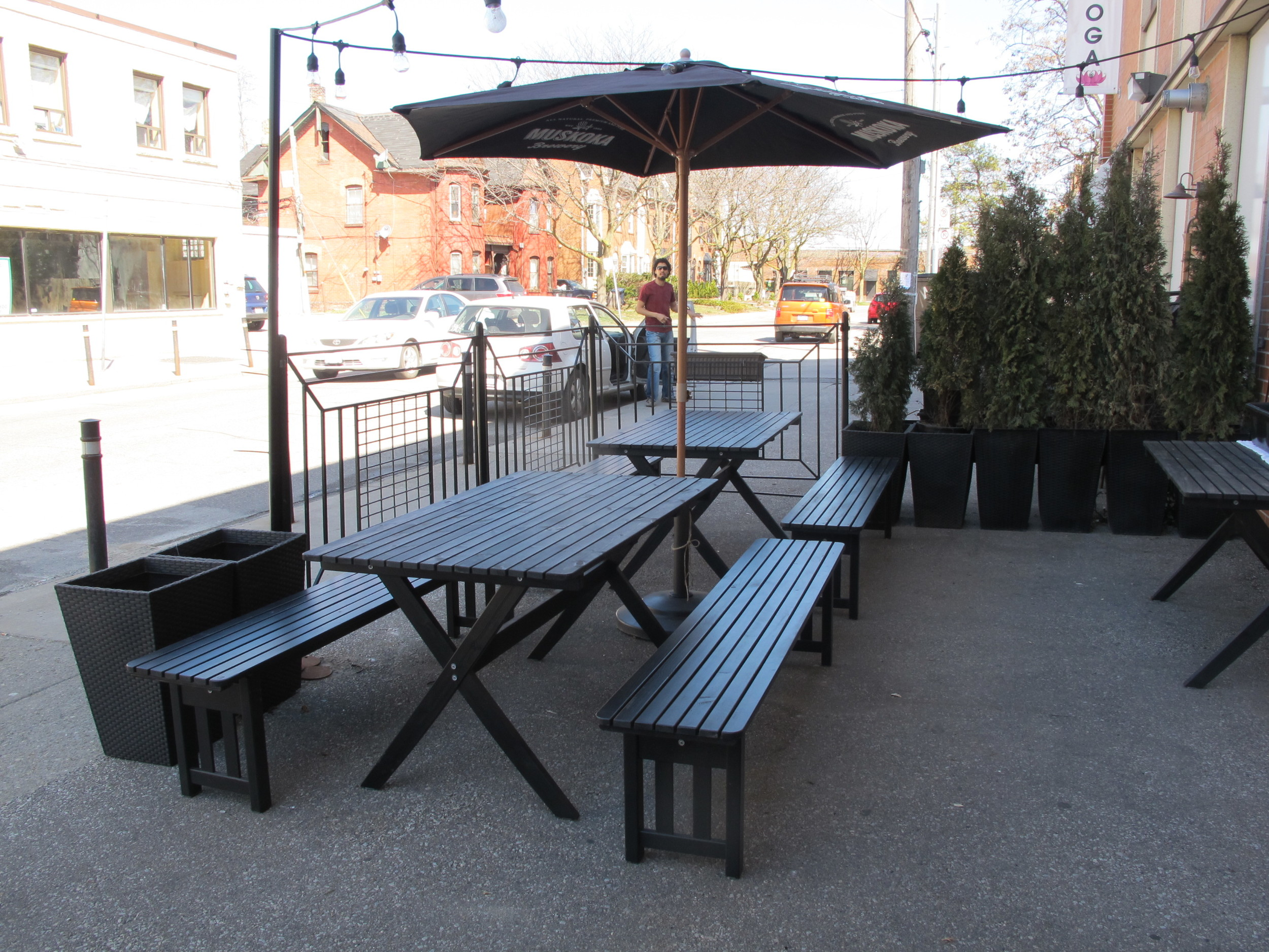 Picture of picnic table on accessible patio from sidewalk level