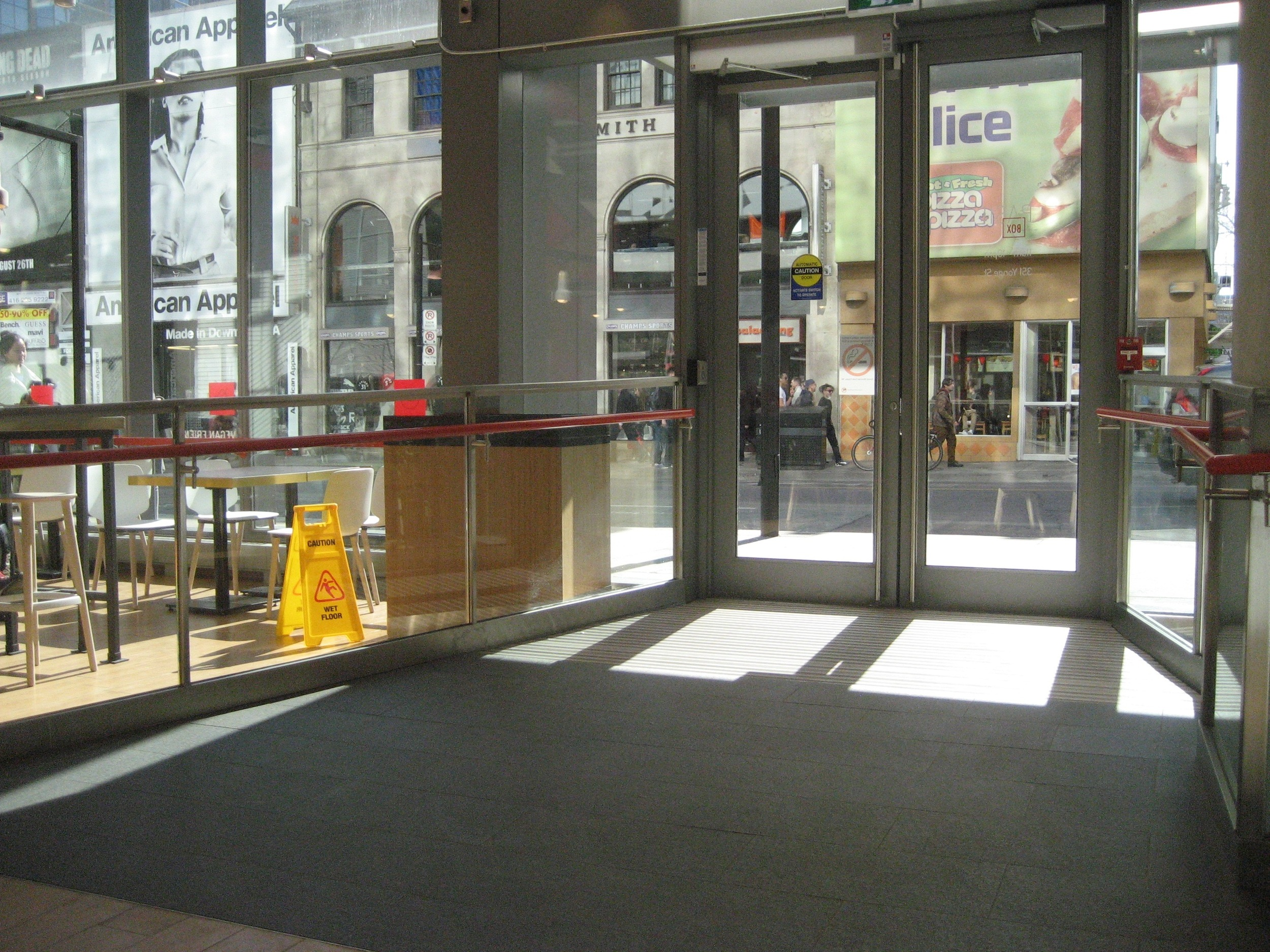 Picture of the accessible entrance from the inside showing where the automatic door opener is located.