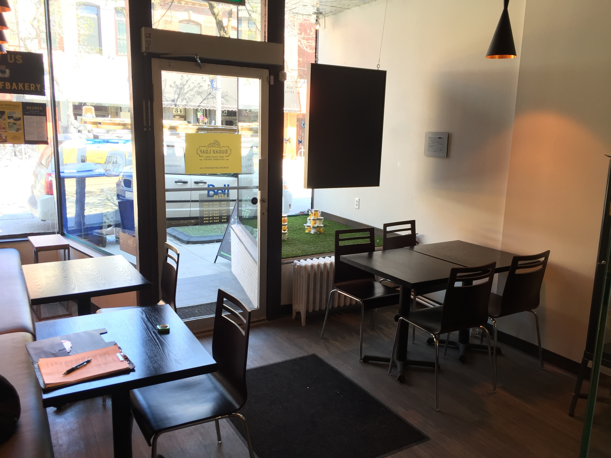 Picture of entrance from the inside. Three standard height tables displayed