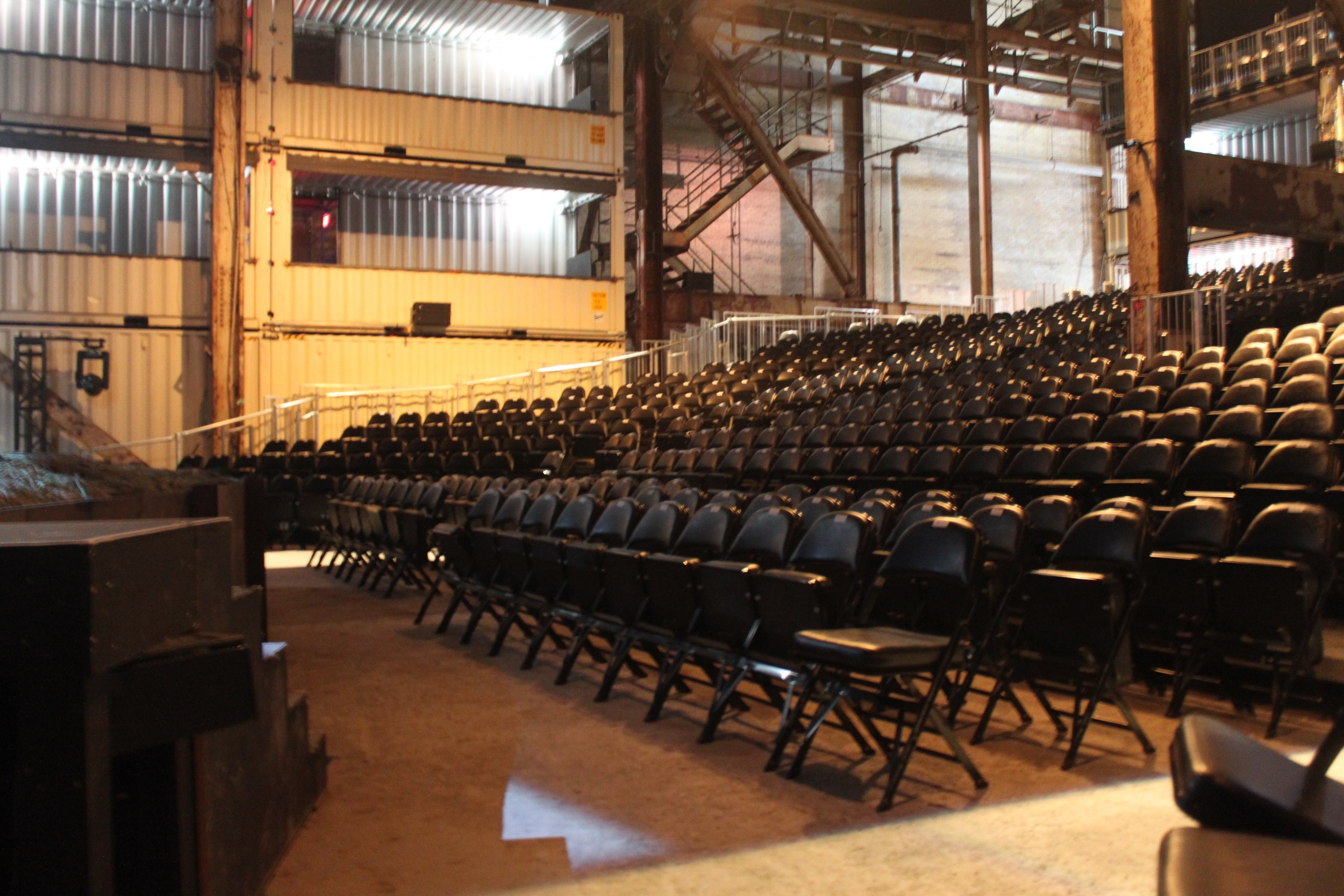 Picture of theater with first two rows featuring accessible seating