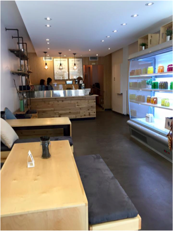 Picture of interior of the juicery. Wide pathway displayed throughout space