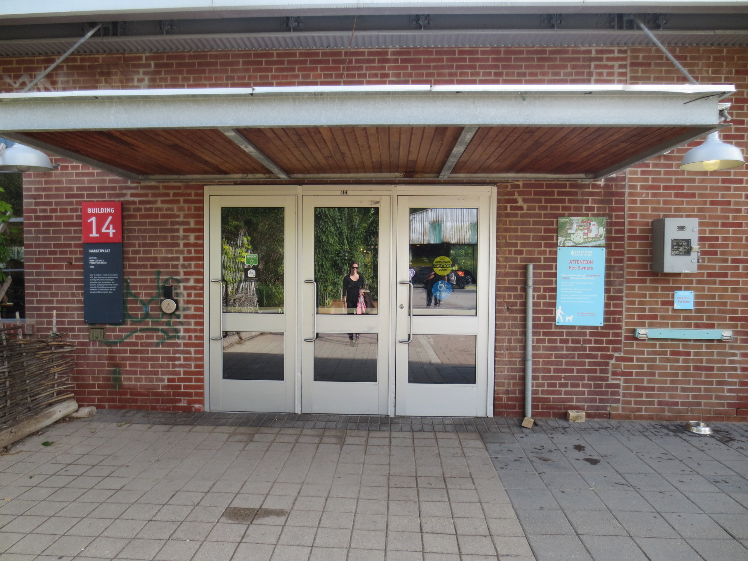 Picture of the main entrance showing automatic button