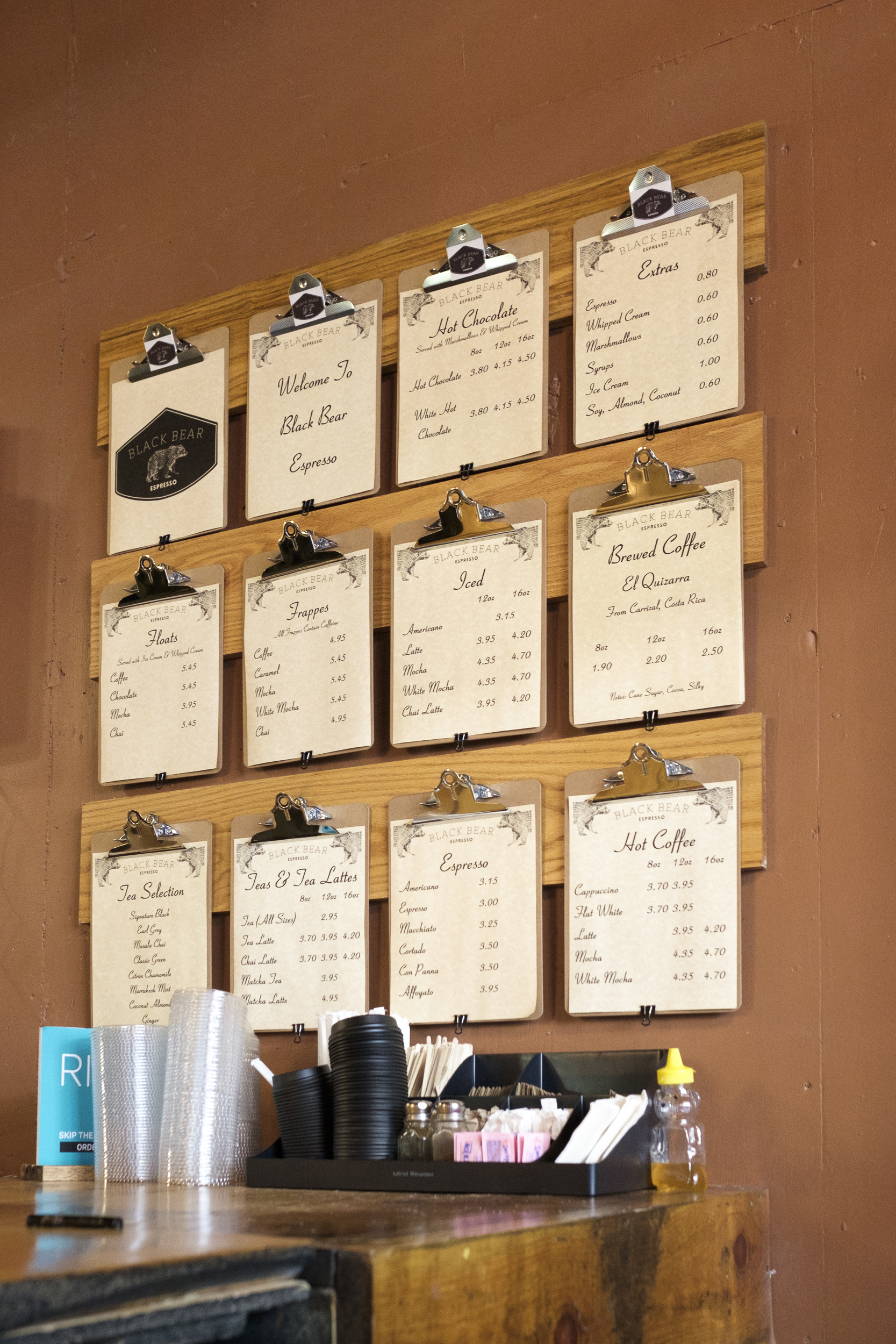 Picture of menu on boards mounted to the wall