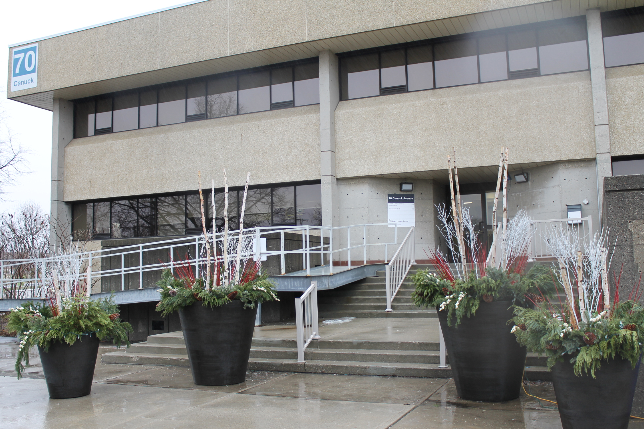 Picture of the front of the building. Long ramp displayed on the left