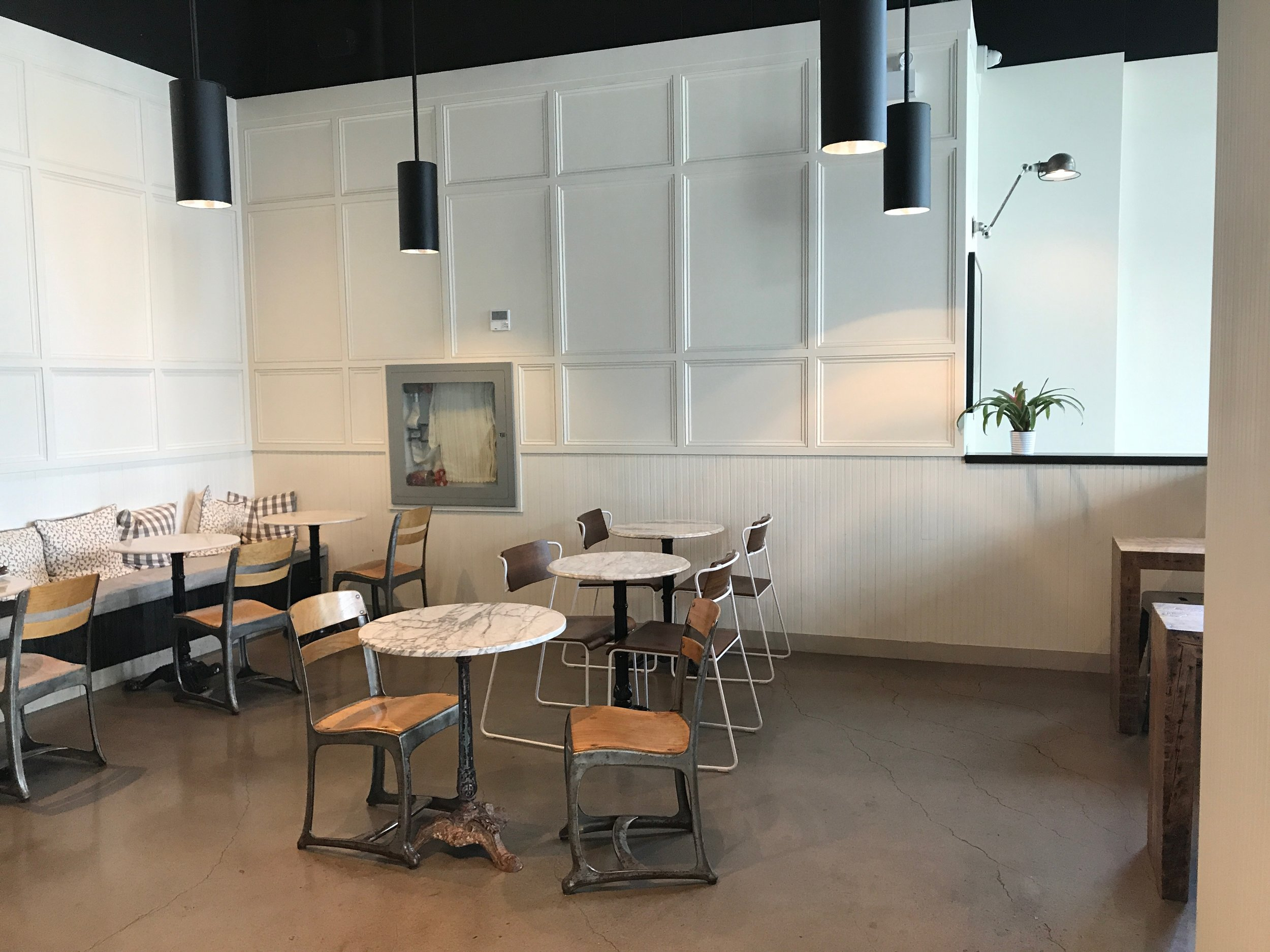 Picture of seating area with tables and removable chairs