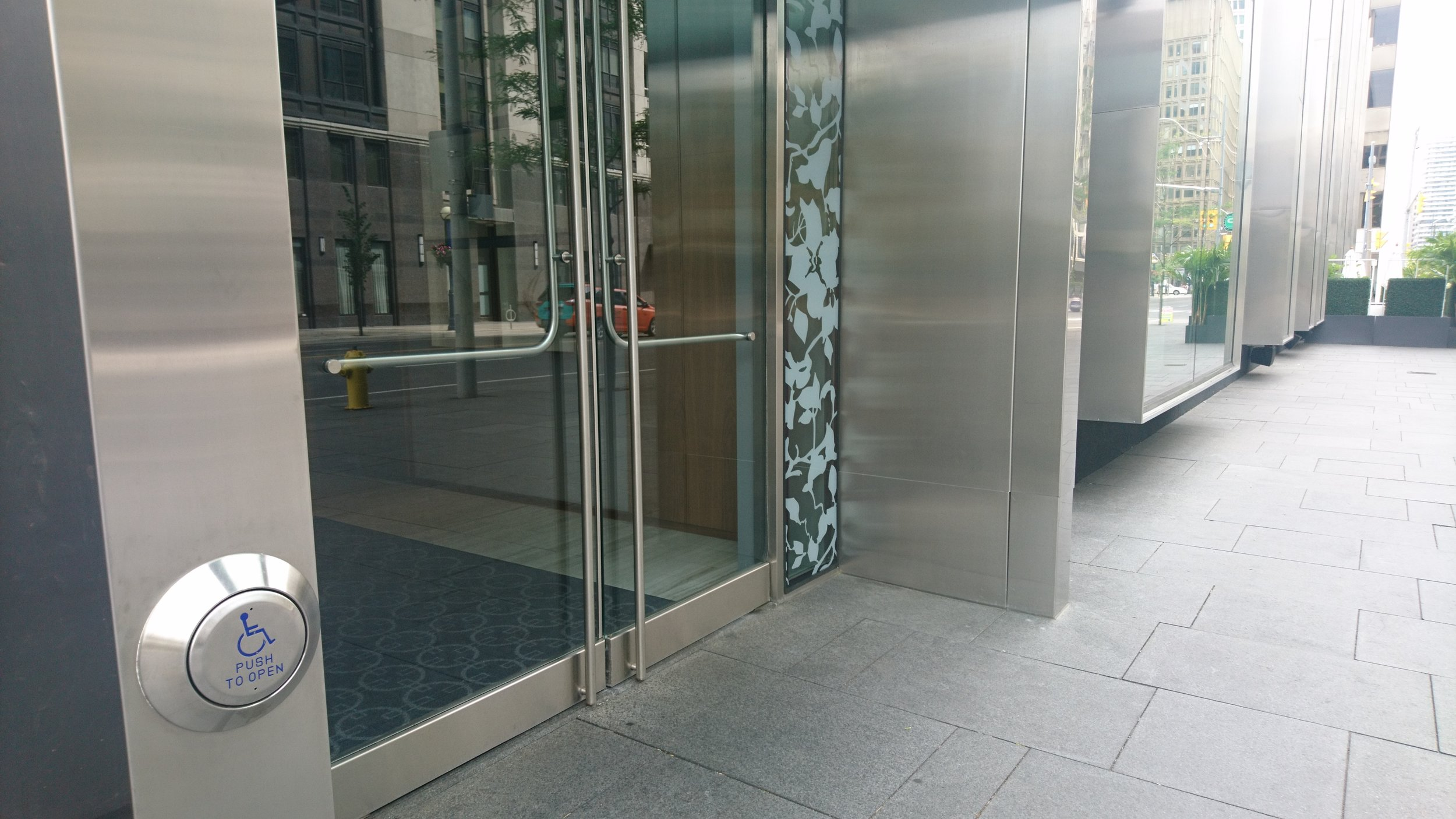 Picture of automatic door opener outside main entrance of D Bar