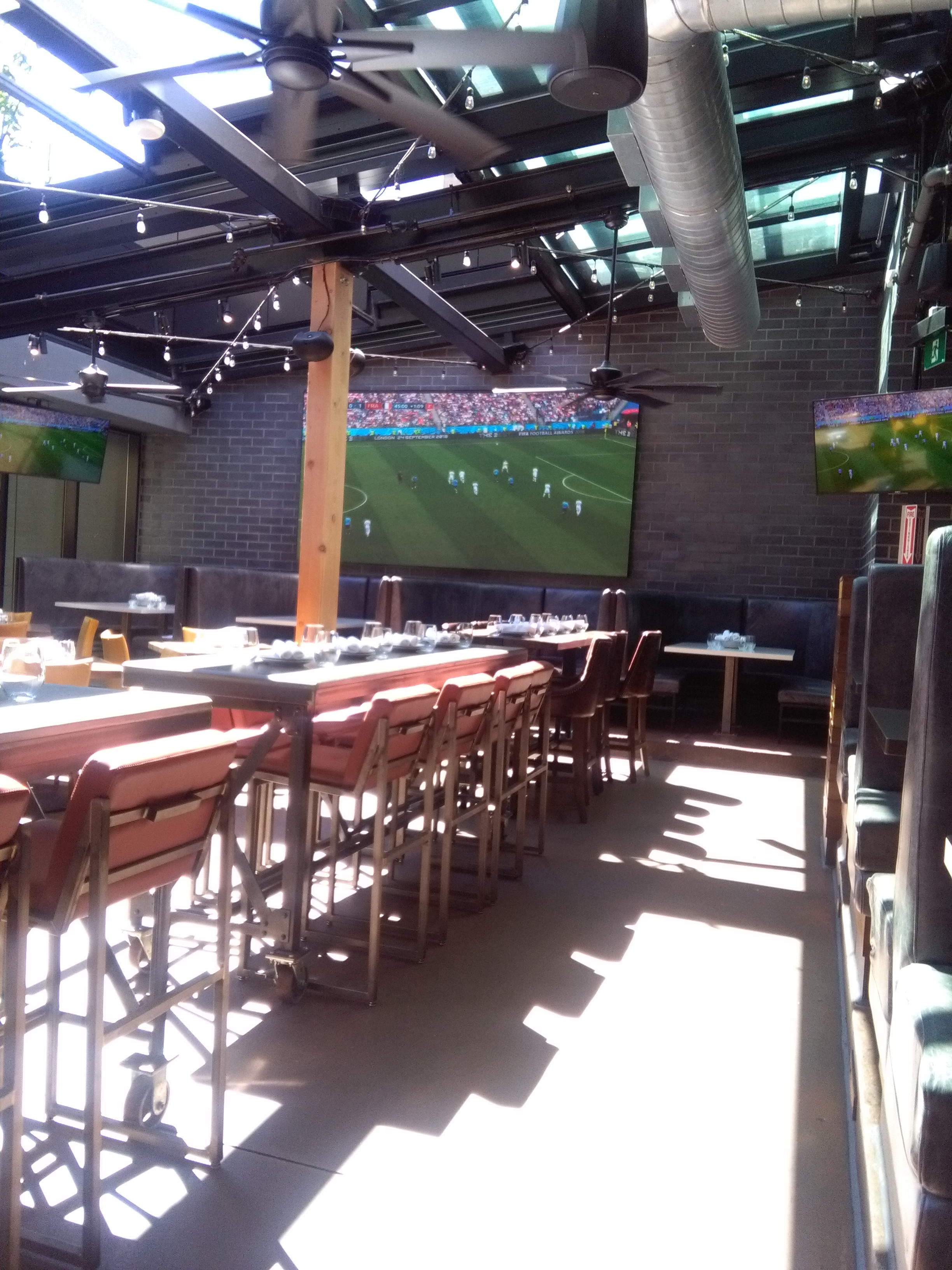 Picture of bar height tables inside Kellys Landing