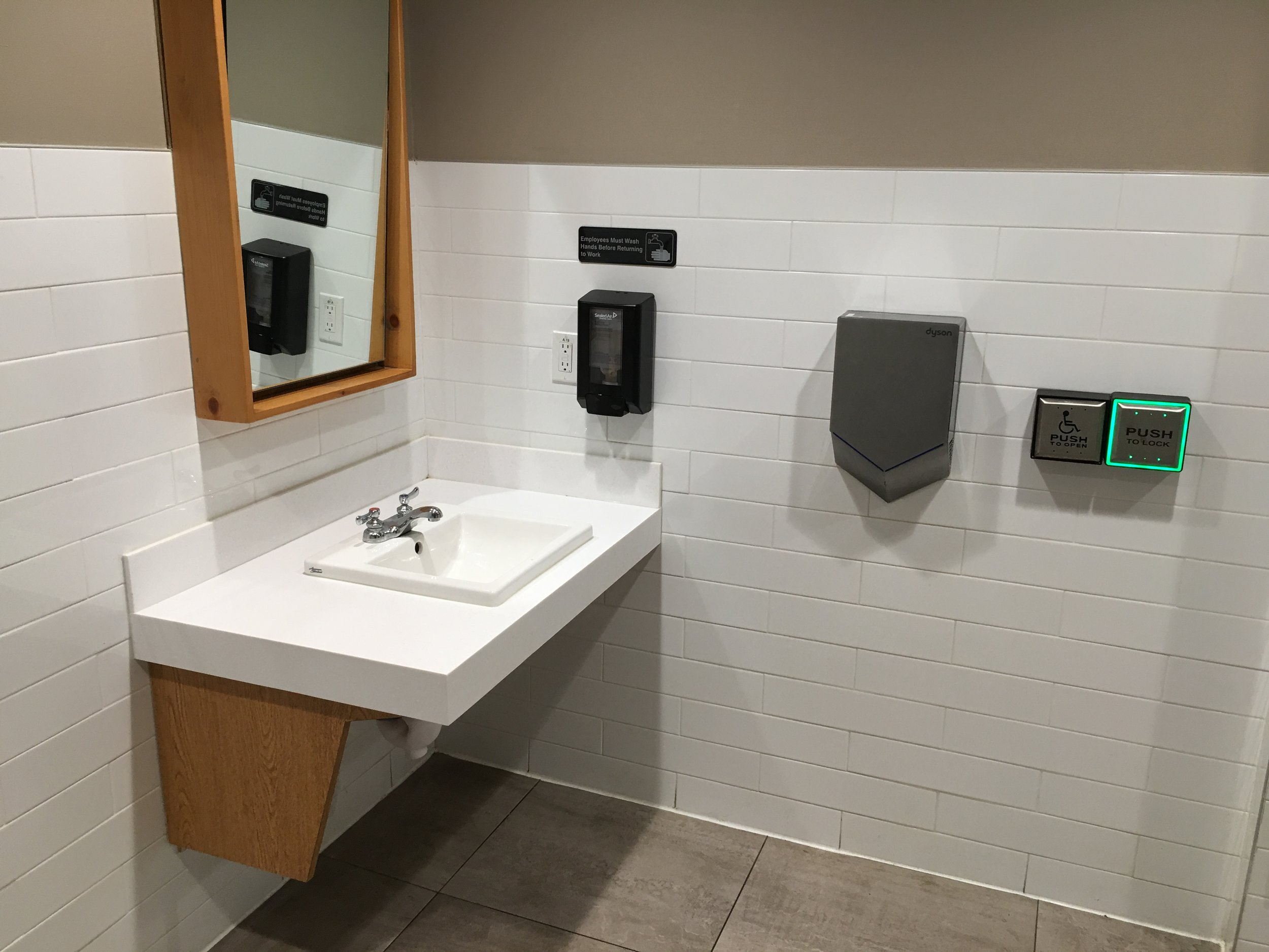 Picture of unobstructed sink and automatic dryer in the washroom