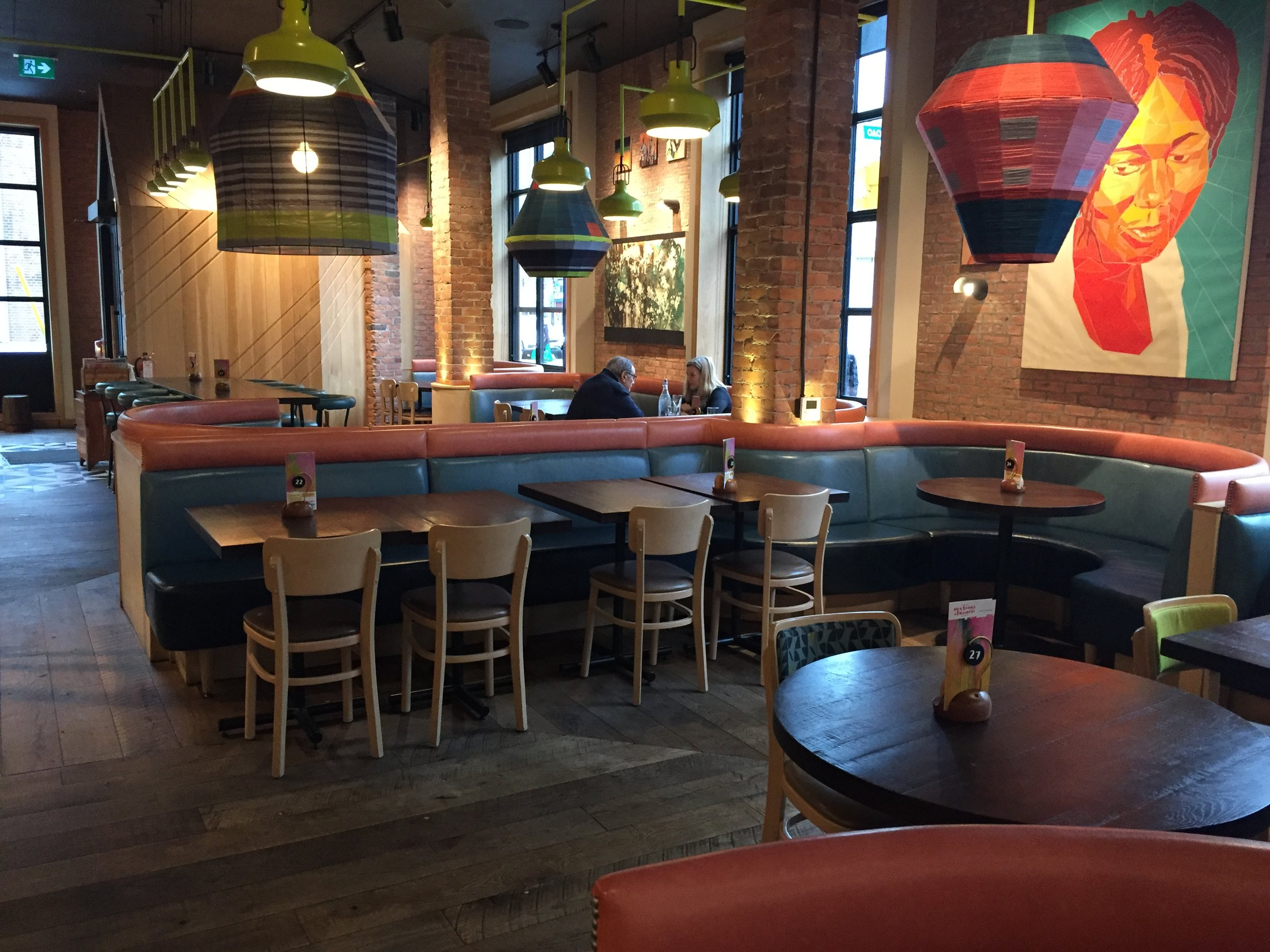 Picture of large seating booths in Nando's Danforth