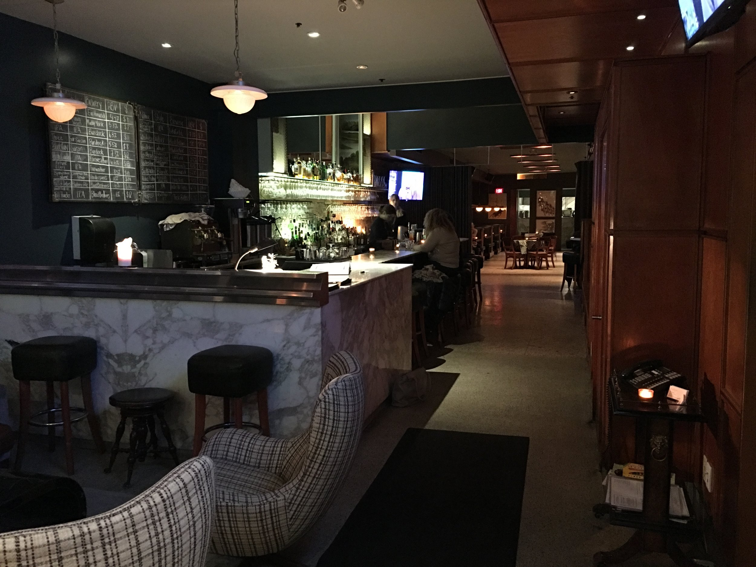 Picture of the bar and pathway to the dining area of the Peacock