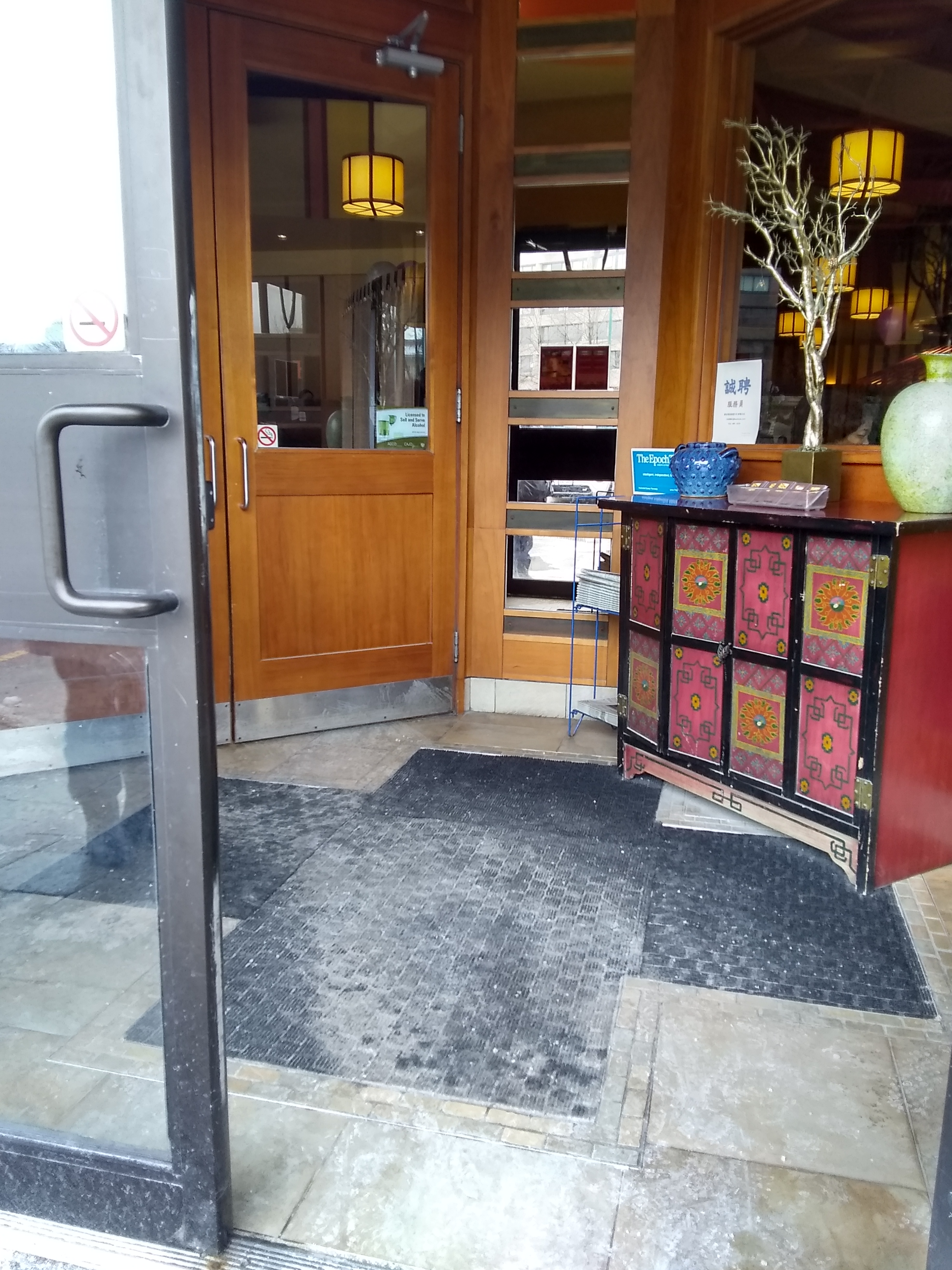 Picture of the sidewalk level entrance of Mongolian Grill