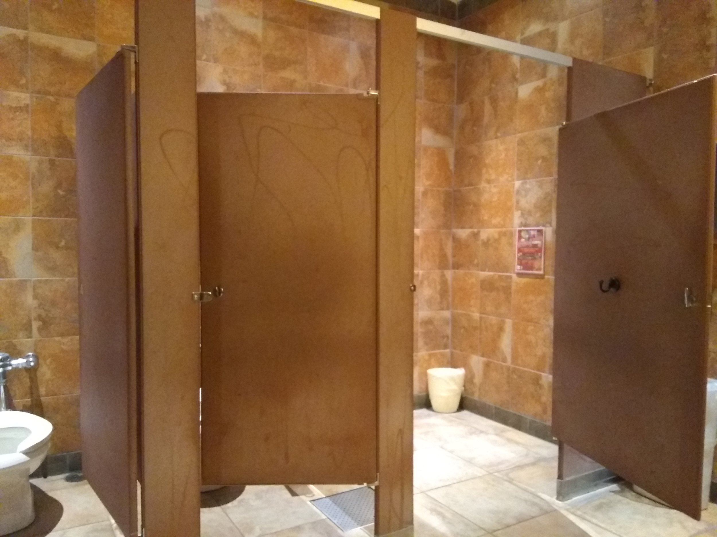 Picture of the entrance to the accessible washroom stall