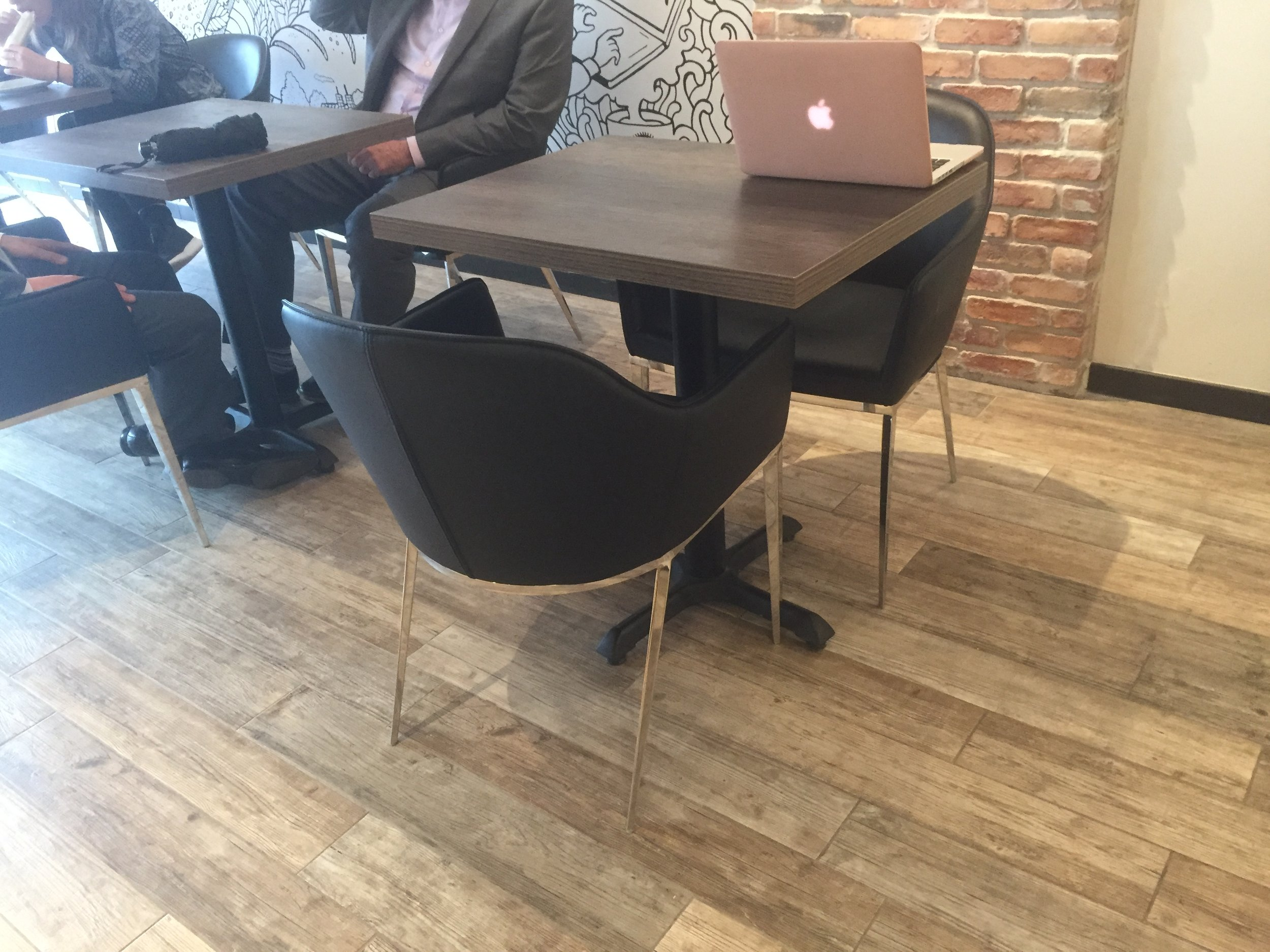 Picture of standard height table with removable chairs at Oliva