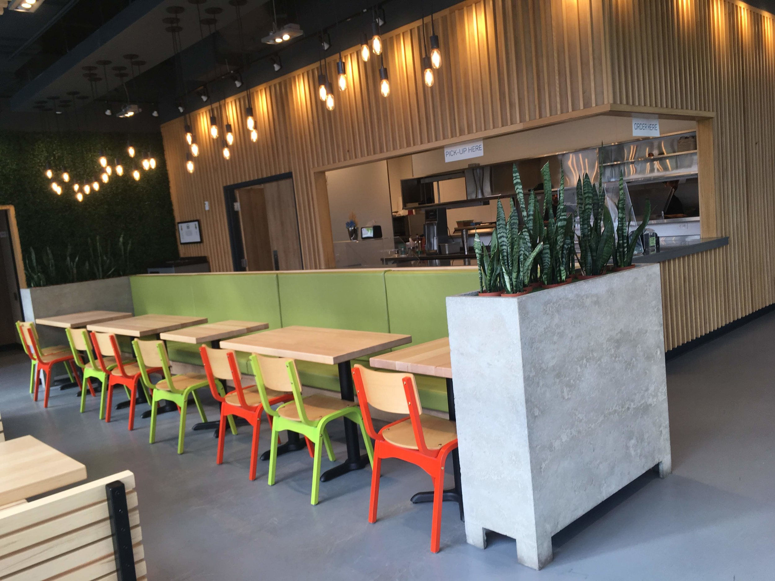 Picture of standard height tables and colorful chairs at Burgers Park