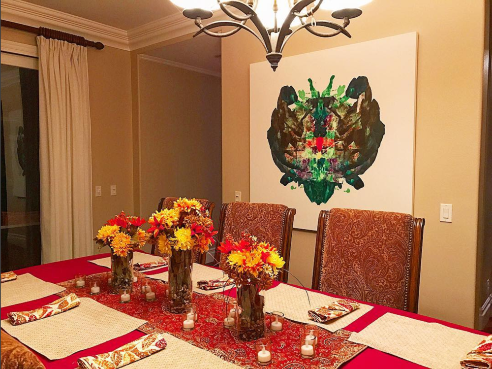 A piece serves as a backdrop to the dining room table at Chad M.'s home in Irvine, California.