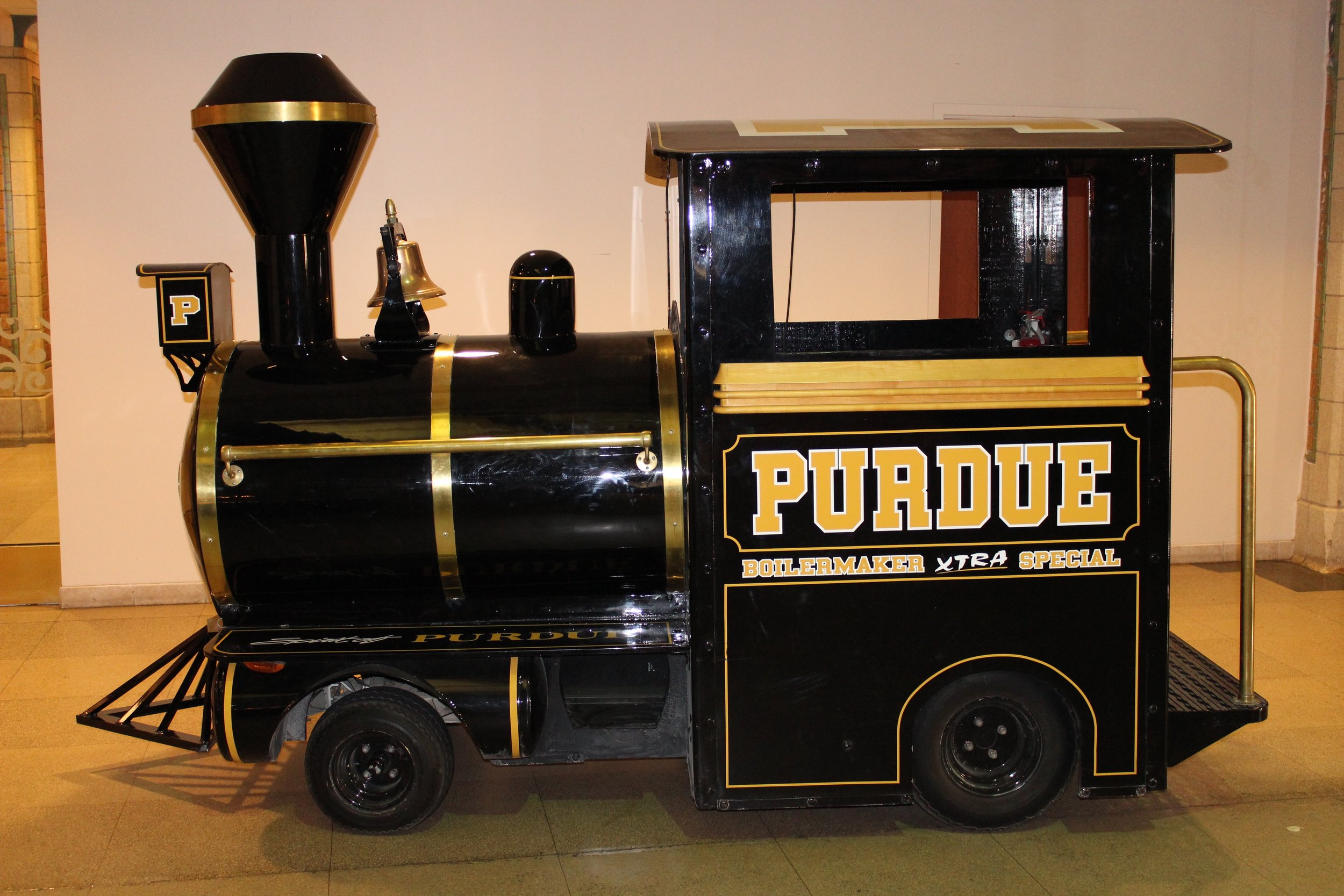 """Jordan & Jason rode the Purdue Xtra Special for their grand entrance (her Dad's """"connections"""")!"""