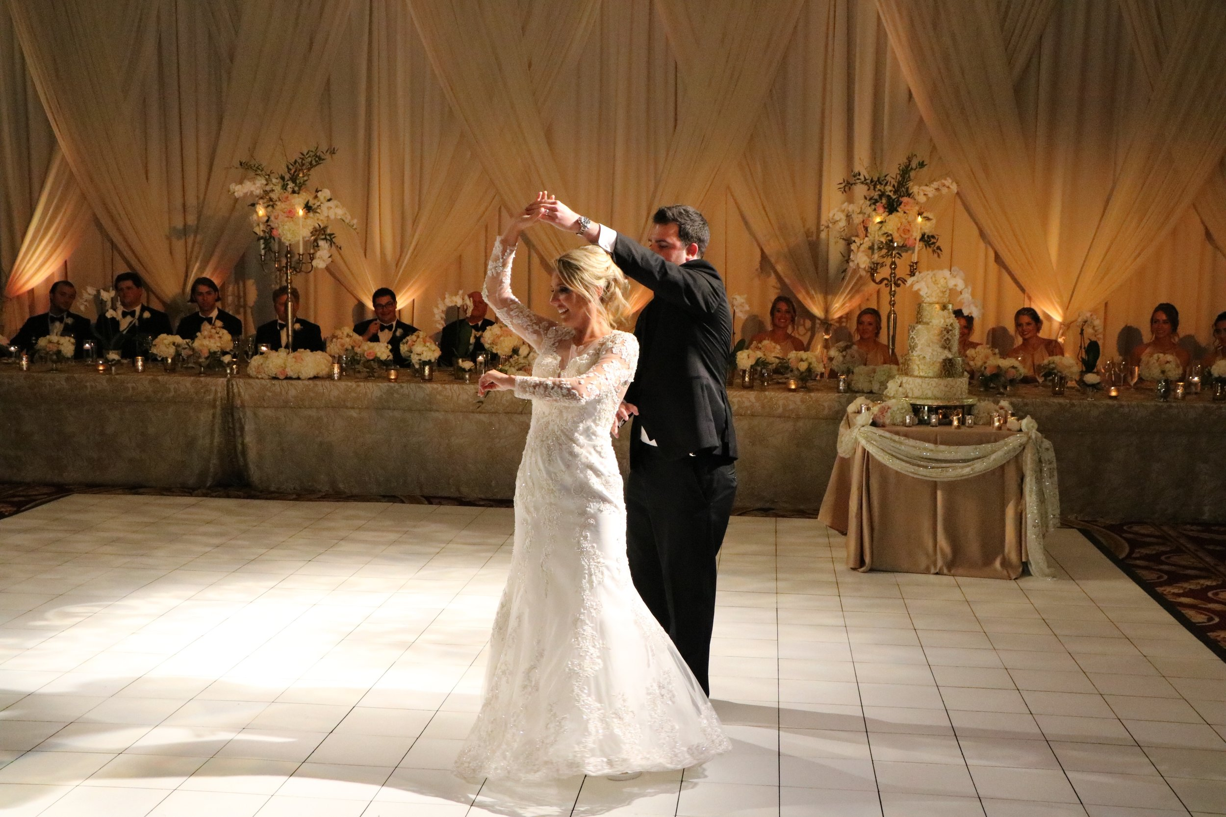 "Erica & Grant wowed guests with their beautiful rehearsed dance to ""All of Me"" by John Legend"