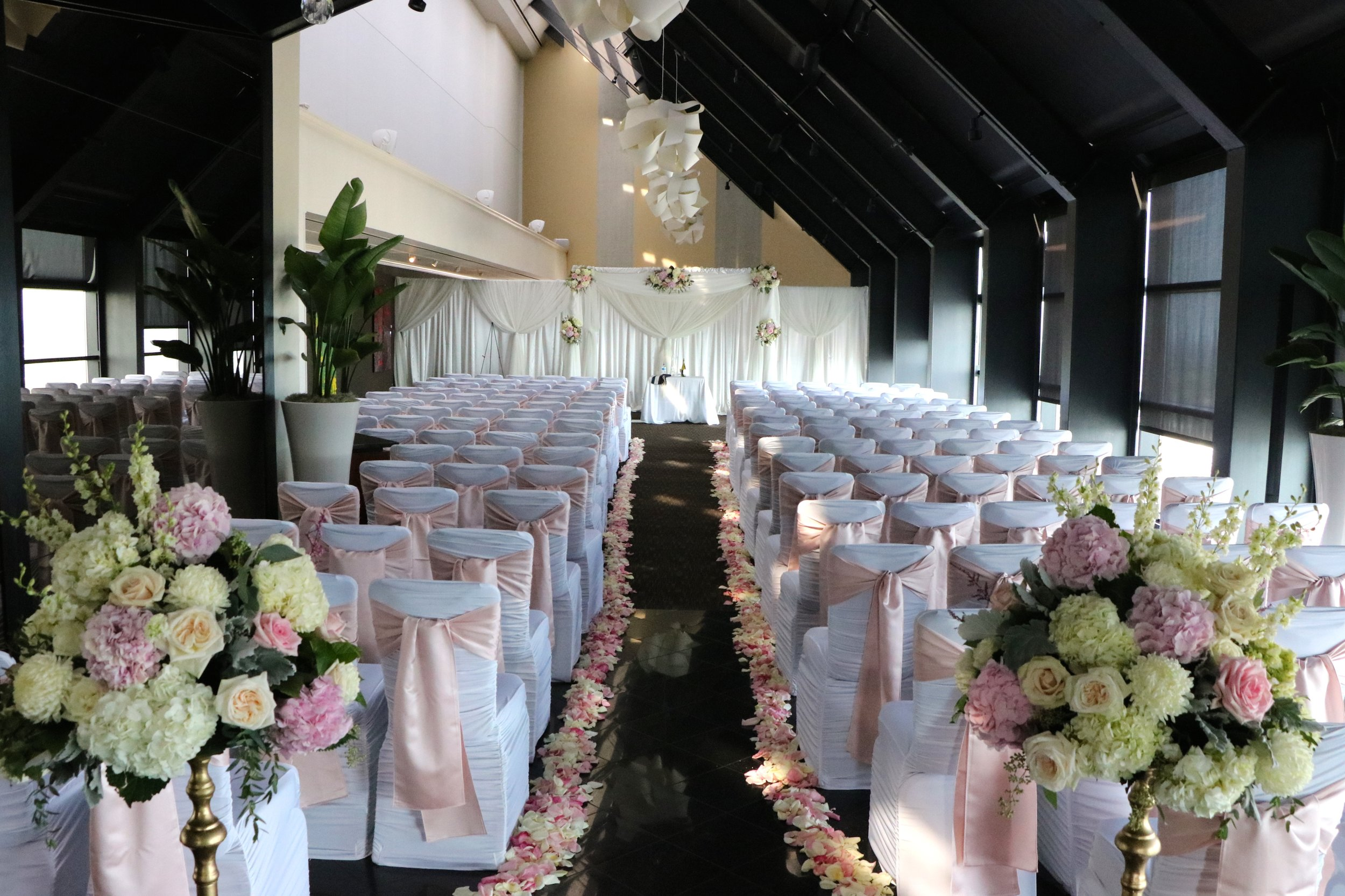 Beautiful flowers and petals lead to their chuppah