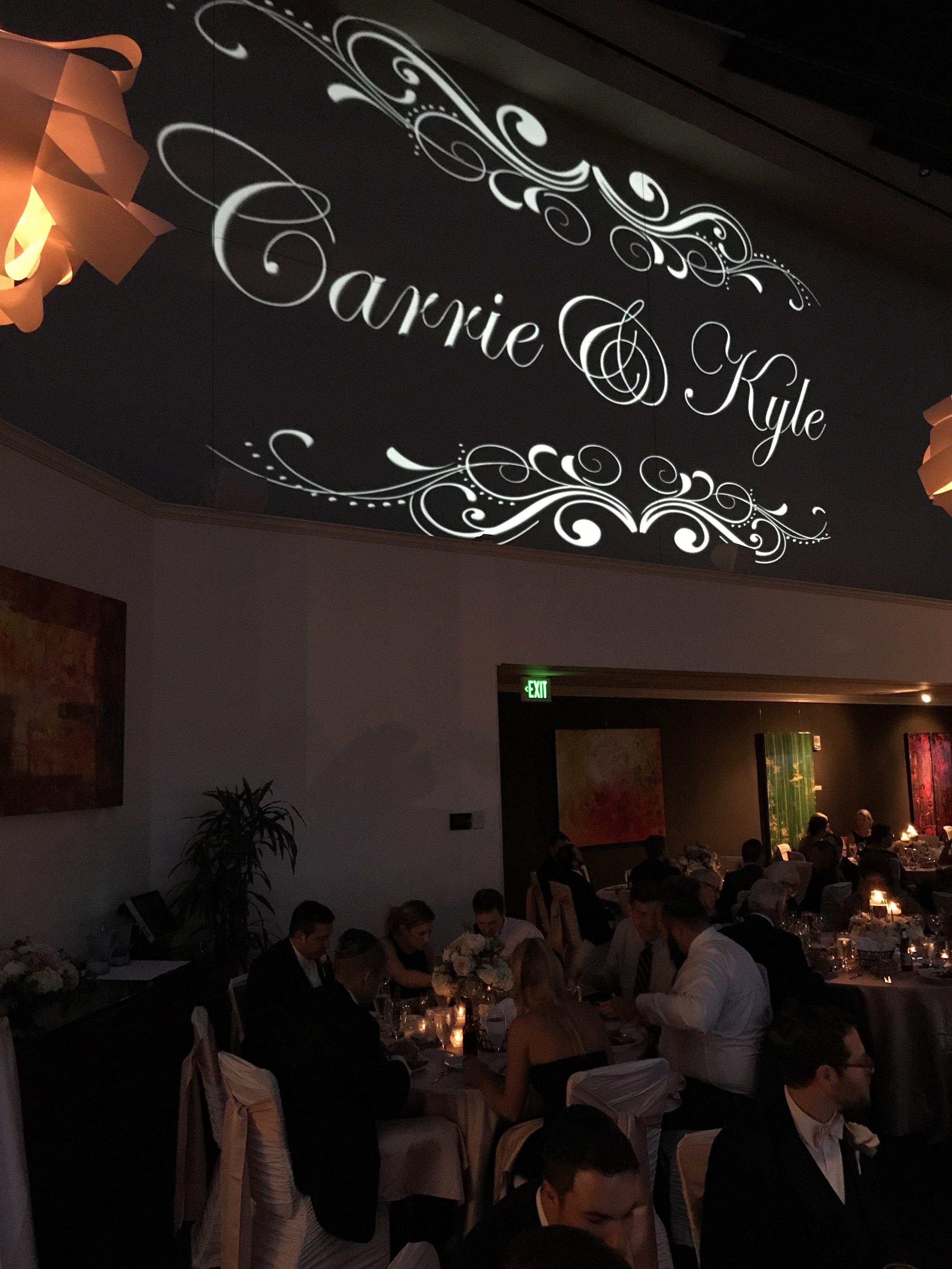 The Skyline Club's huge canvas for Carrie & Kyle's custom monogram by Jim Cerone