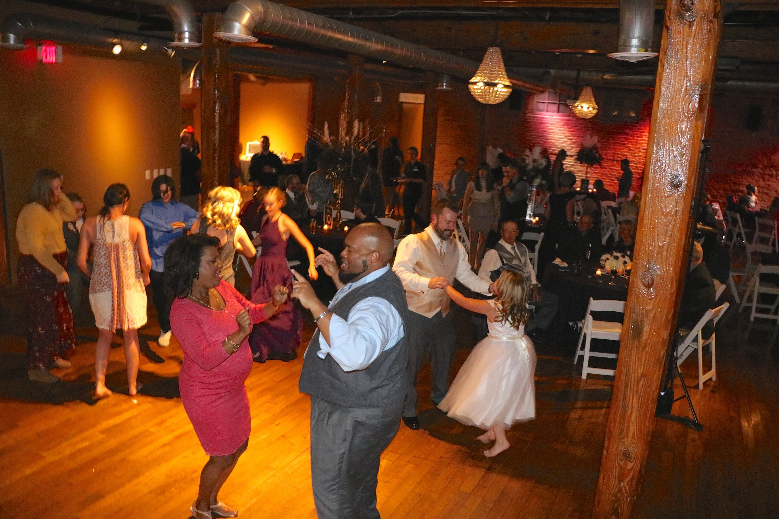 Family and friends get on the dance floor to celebrate with Alexis & Jason!