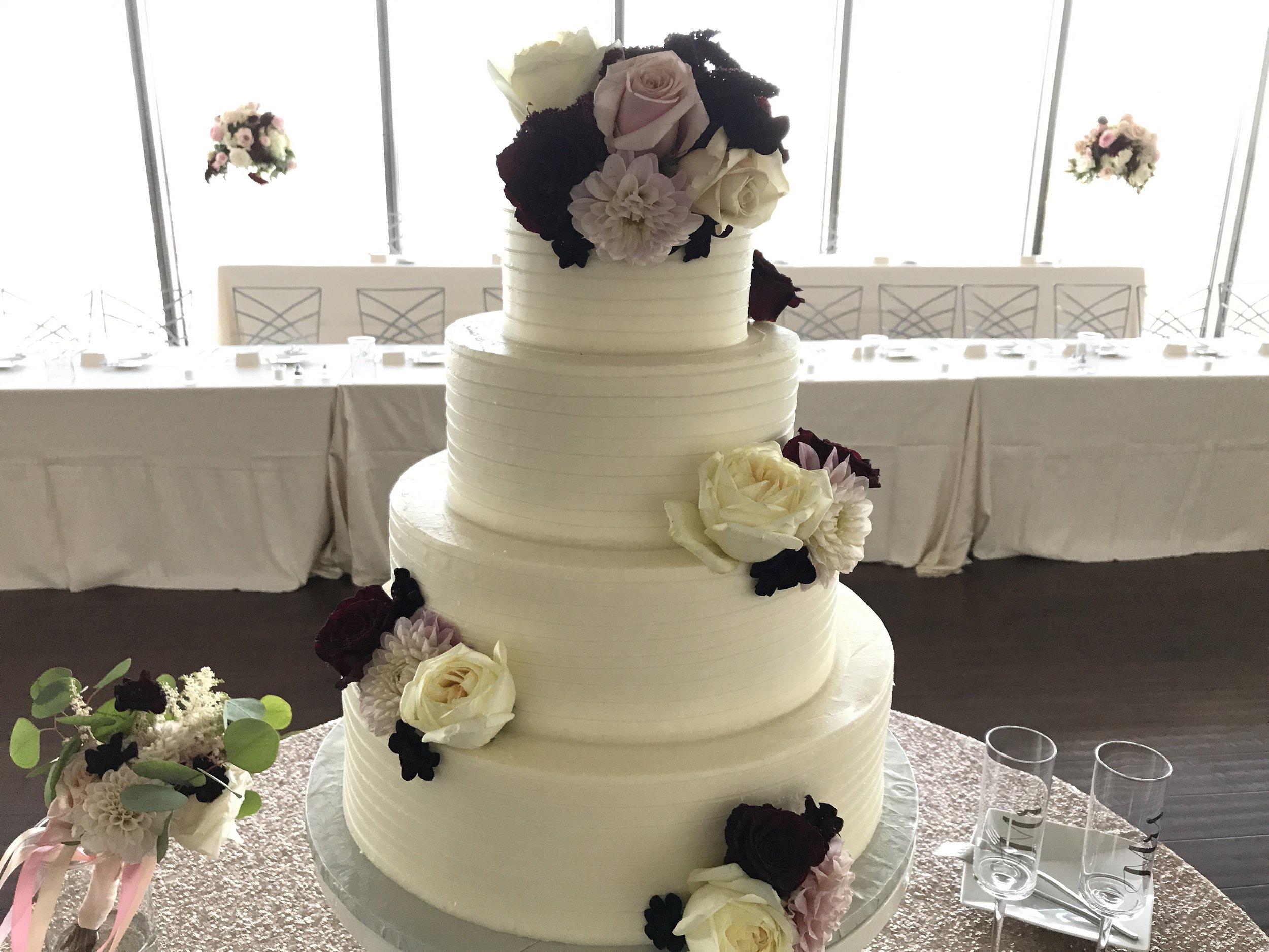 Cake by Classic Cakes Carmel, Flowers by McNamara Indy