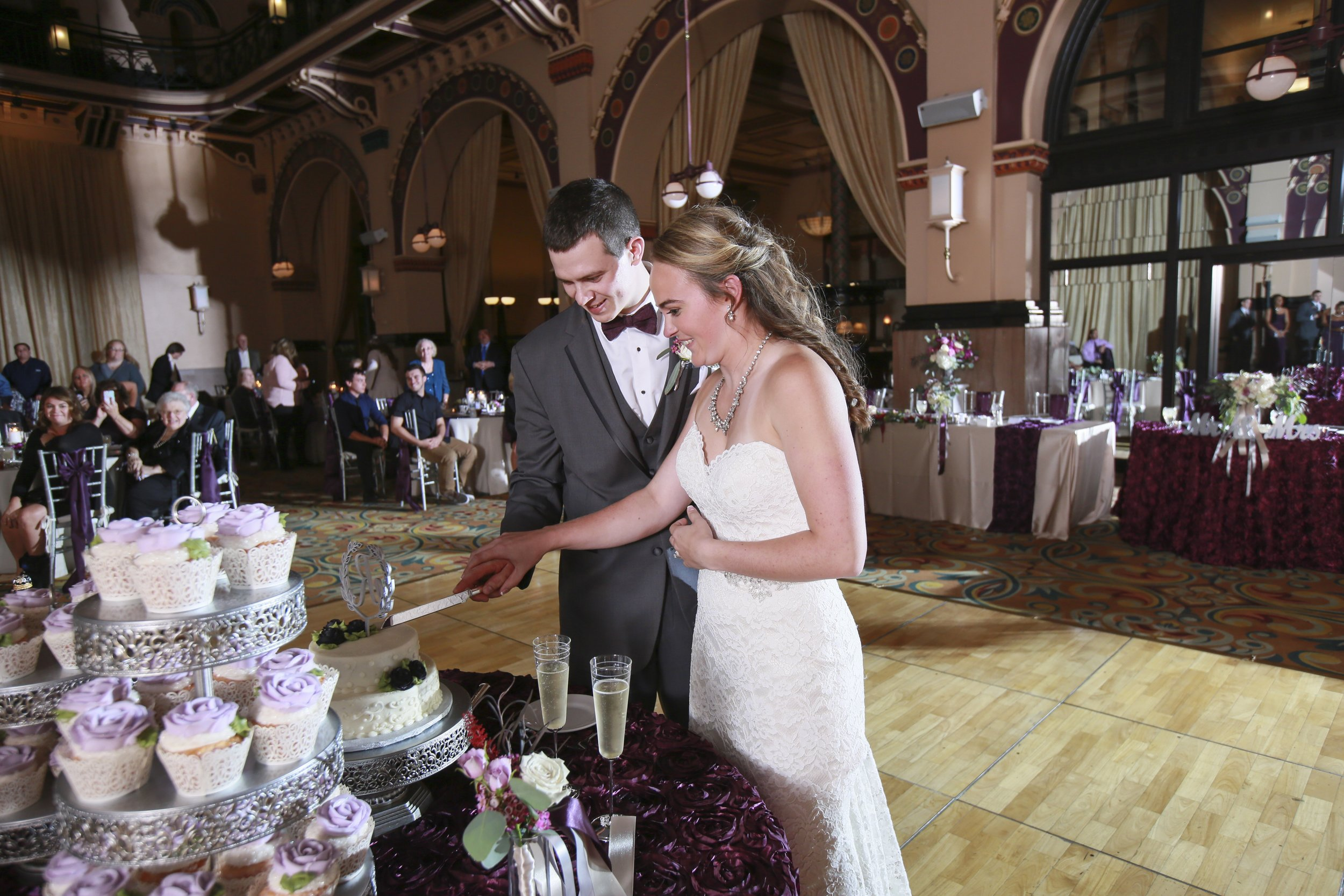 """""""How Sweet It Is"""" - Kelsi & Chris cut their cake and check out the cup cakes! Photo courtesy  Jennifer Driscoll Photography"""