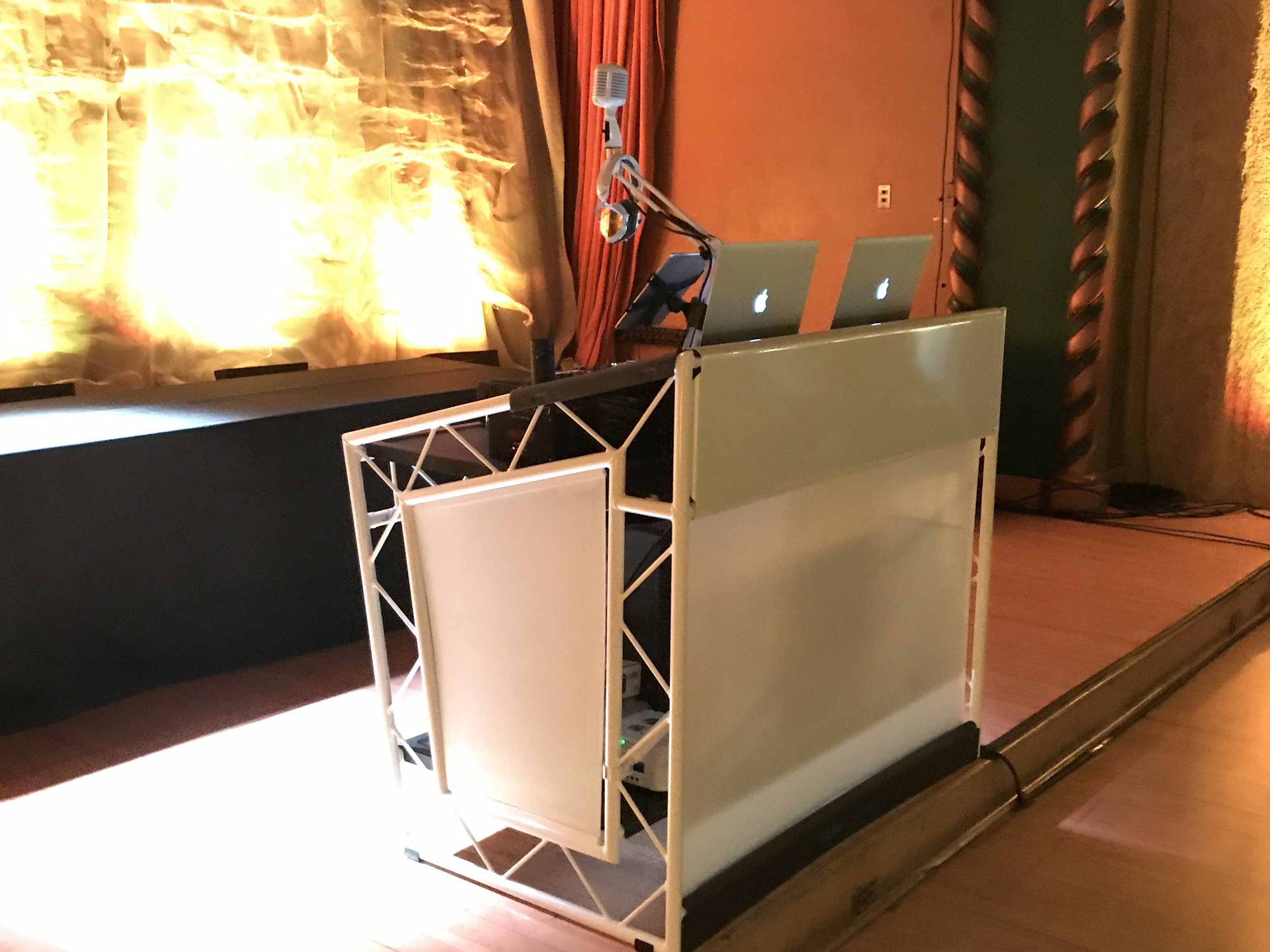 New for 2018? All white DJ booth which can be lit with your colors or include a flat screen TV.