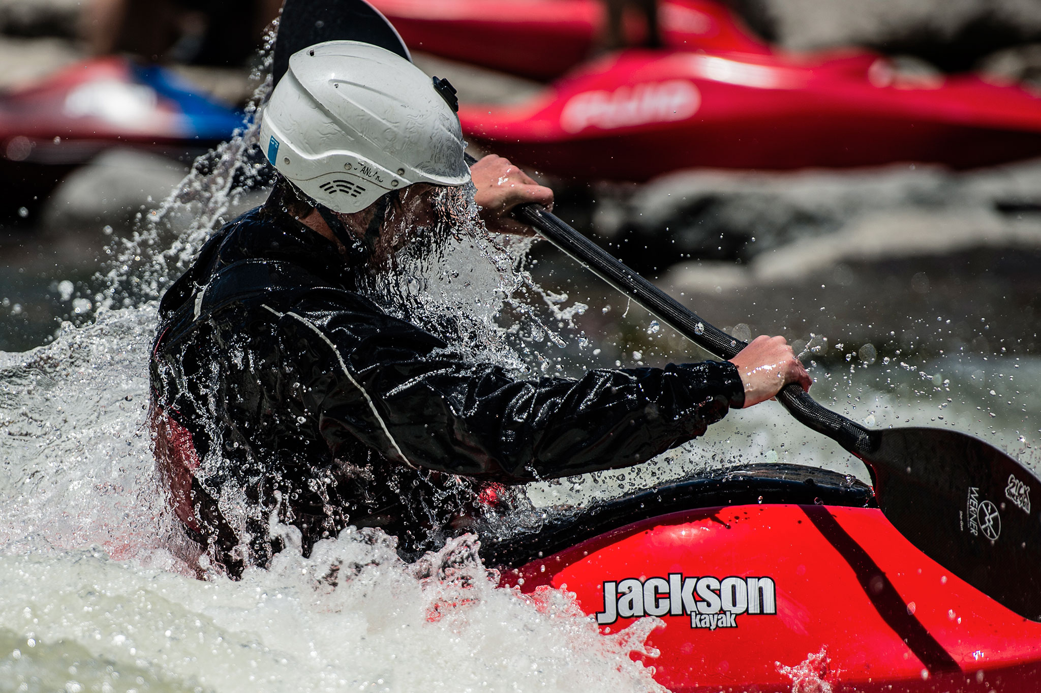 A kayaker emerges from under the water in the San Juan river in southern Colorado