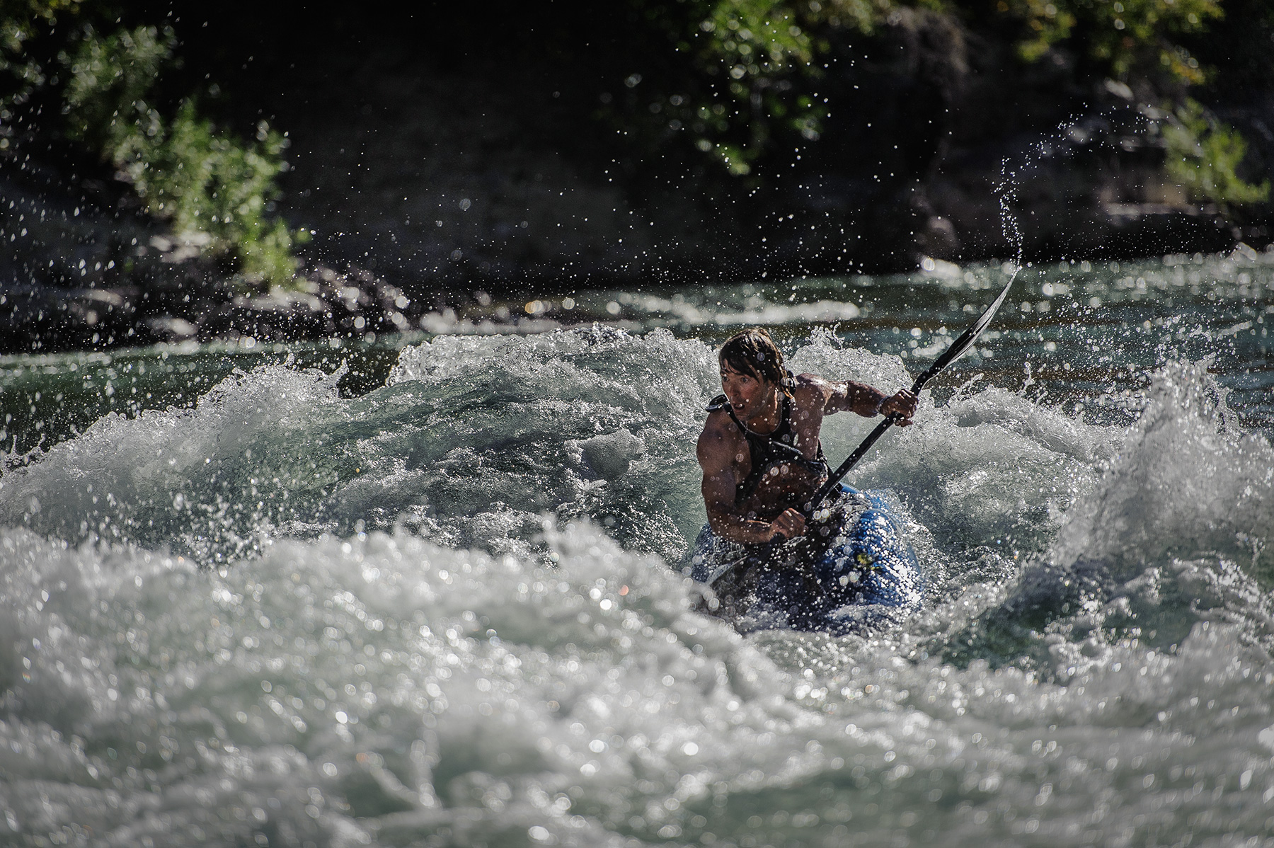 A kayaker plunges into rough waters in a hard stretch of the Snake River in Wyoming