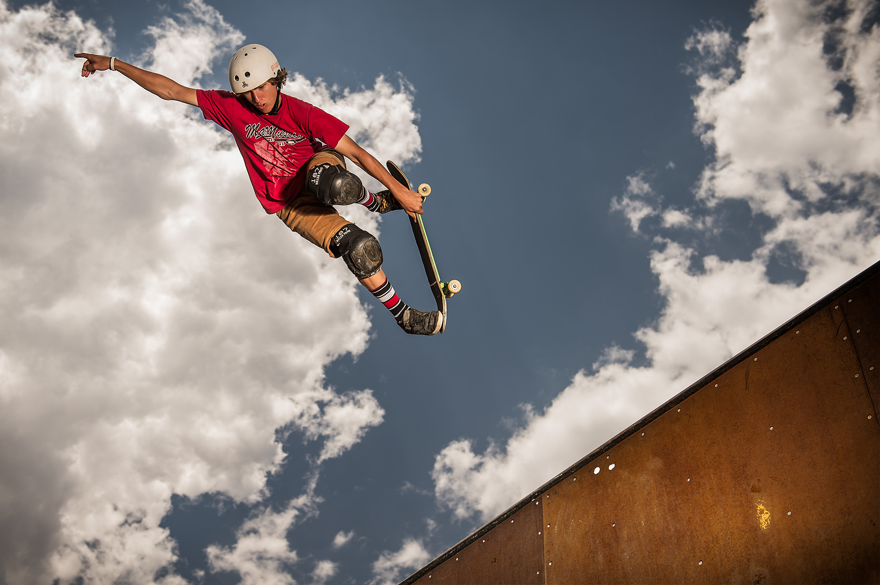A skateboarder flies high into the sky in Colorado Springs, CO
