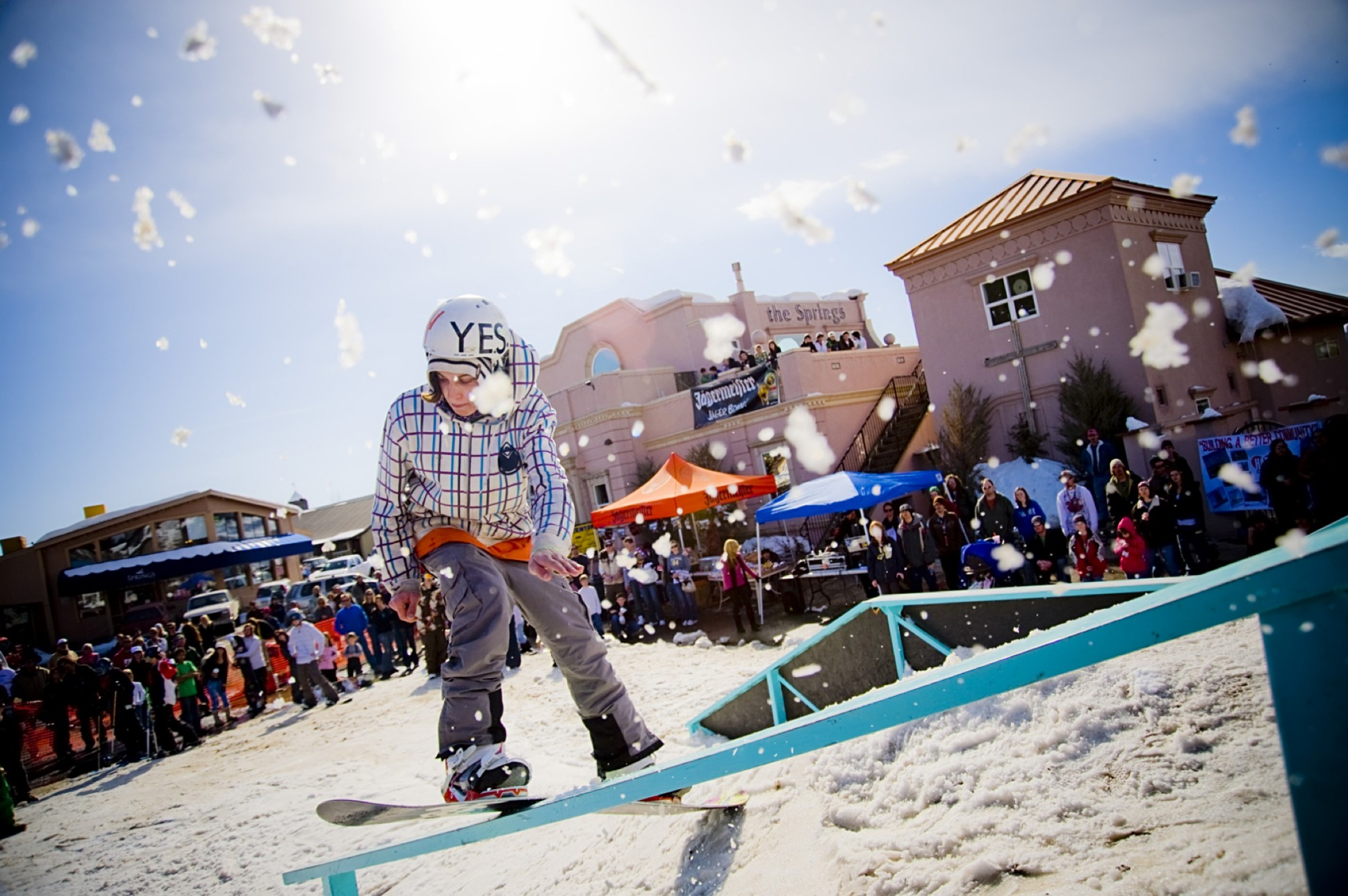 A snowboarder complete a rail slide in an event at The Springs Resort in downtown Pagosa Springs