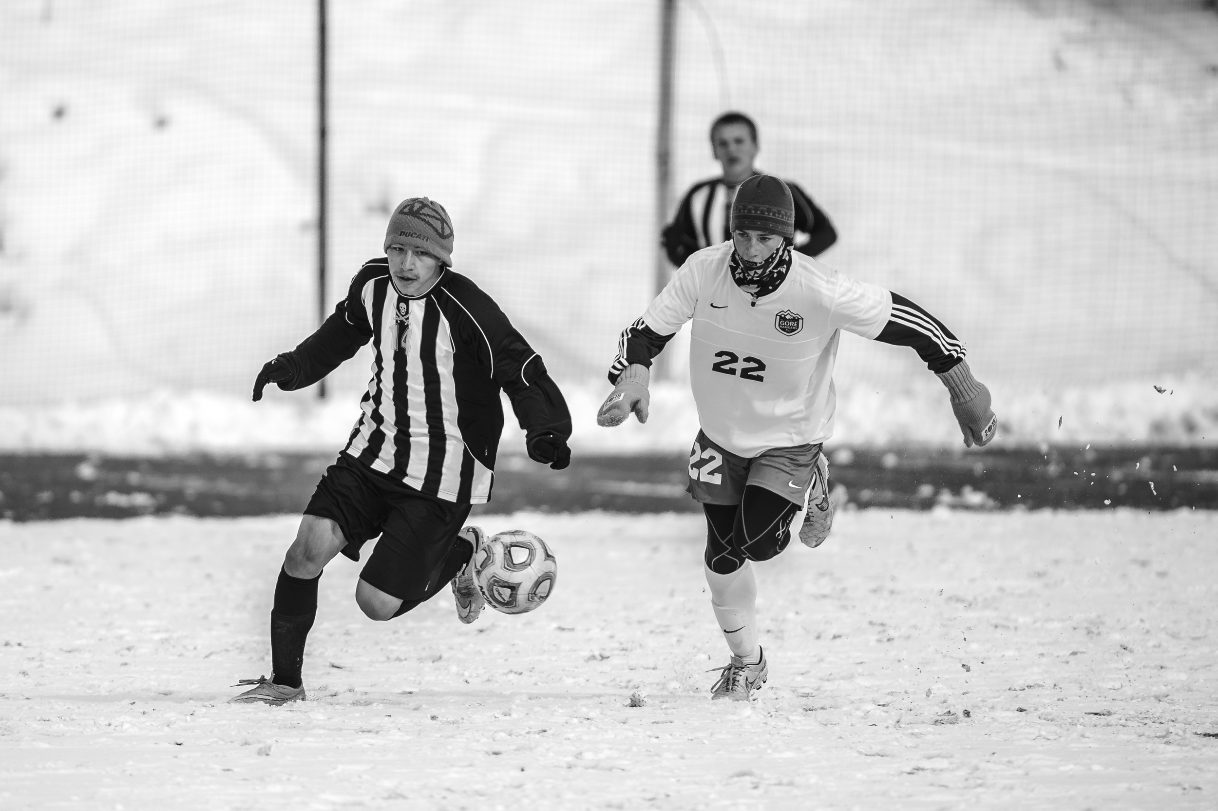Players battle each other and the elements during a playoff soccer game